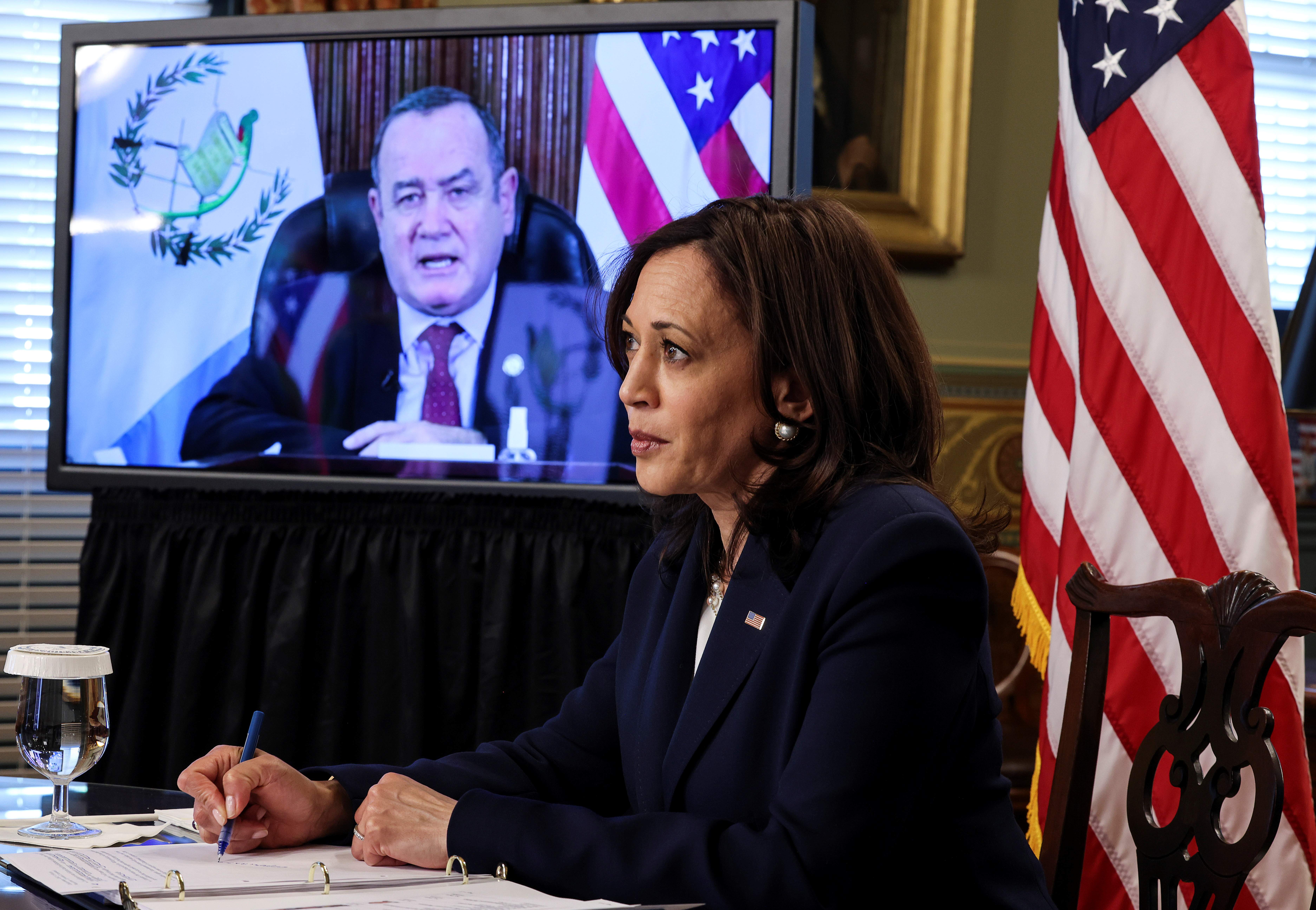 U.S. Vice President Kamala Harris takes notes as she speaks via videoconference with Guatemala's President Alejandro Giammattei to discuss solutions to an increase in migration as she looks for ways to defuse a migrant crisis at the U.S. border with Mexico, in the Eisenhower Executive Office Building at the White House in Washington, U.S., April 26, 2021. REUTERS/Evelyn Hockstein