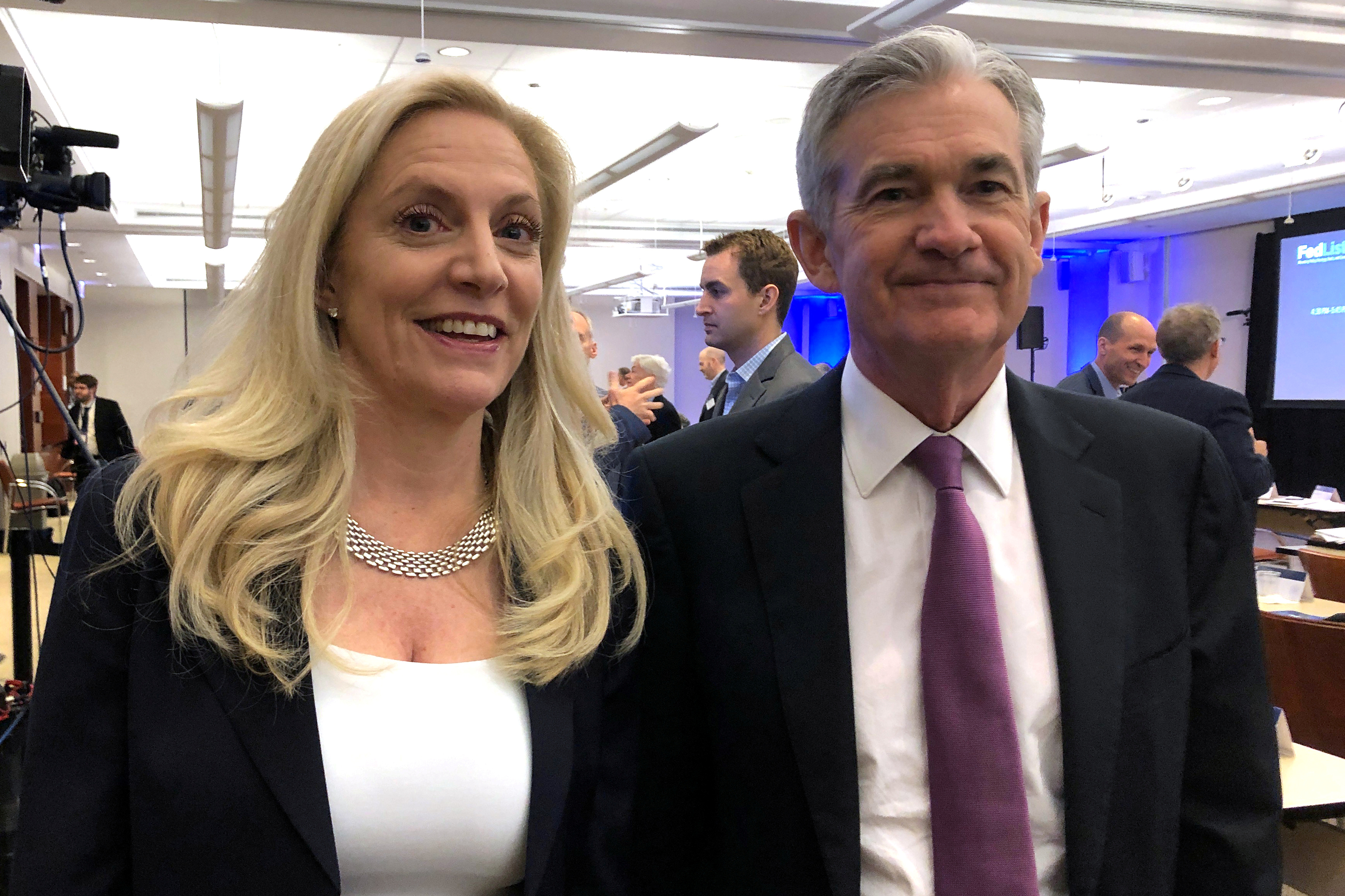 Federal Reserve Chairman Jerome Powell poses for photos with Fed Governor Lael Brainard (L) at the Federal Reserve Bank of Chicago, in Chicago, Illinois, U.S., June 4, 2019. REUTERS/Ann Saphir