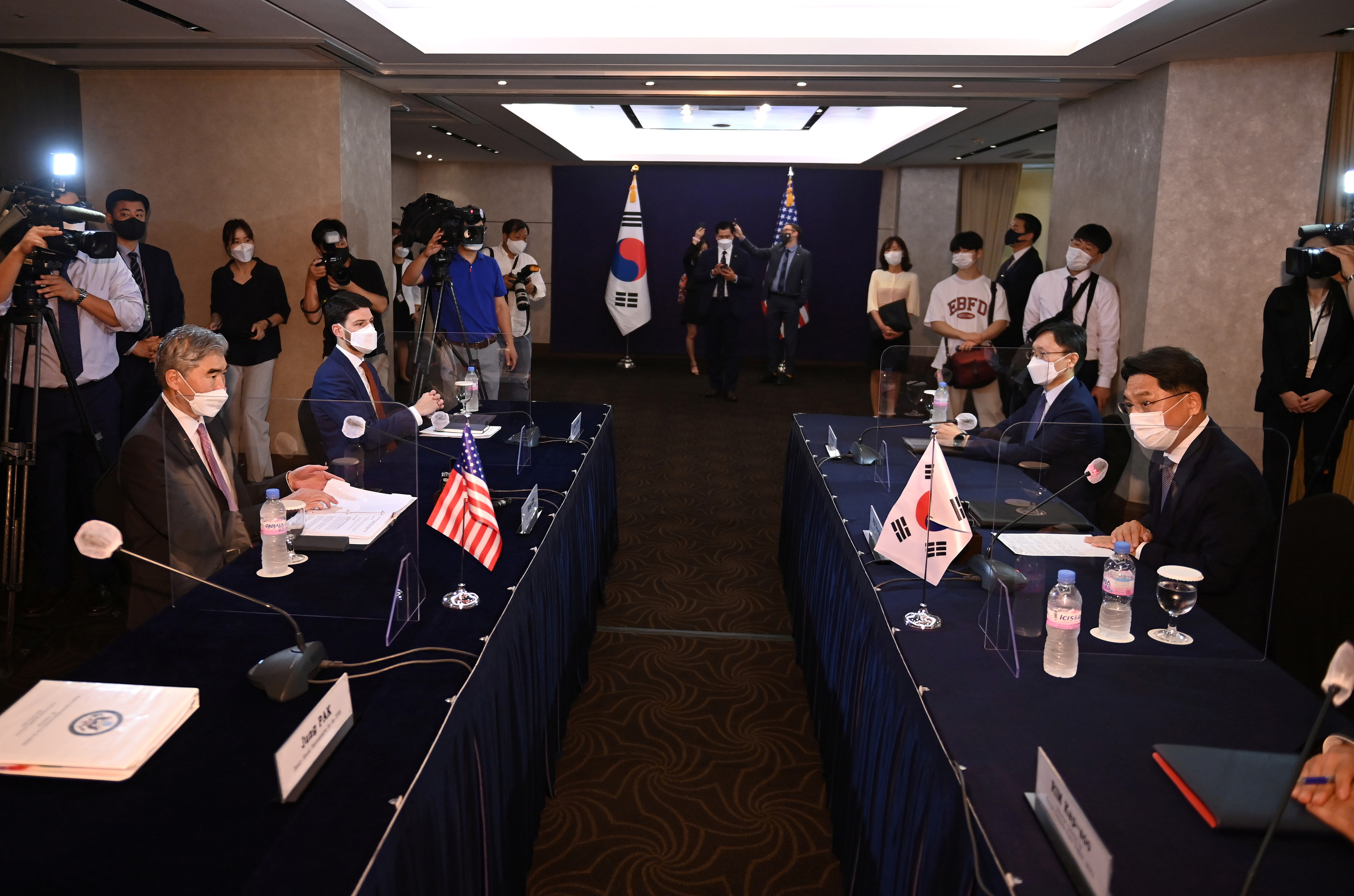 Noh Kyu-duk (R), South Korea's Special Representative for Korean Peninsula Peace and Security Affairs, talks with Sung Kim (L), US Special Representative for North Korea, during their bilateral meeting at a hotel in Seoul , South Korea June 21, 2021. Jung Yeon-Je/Pool via REUTERS
