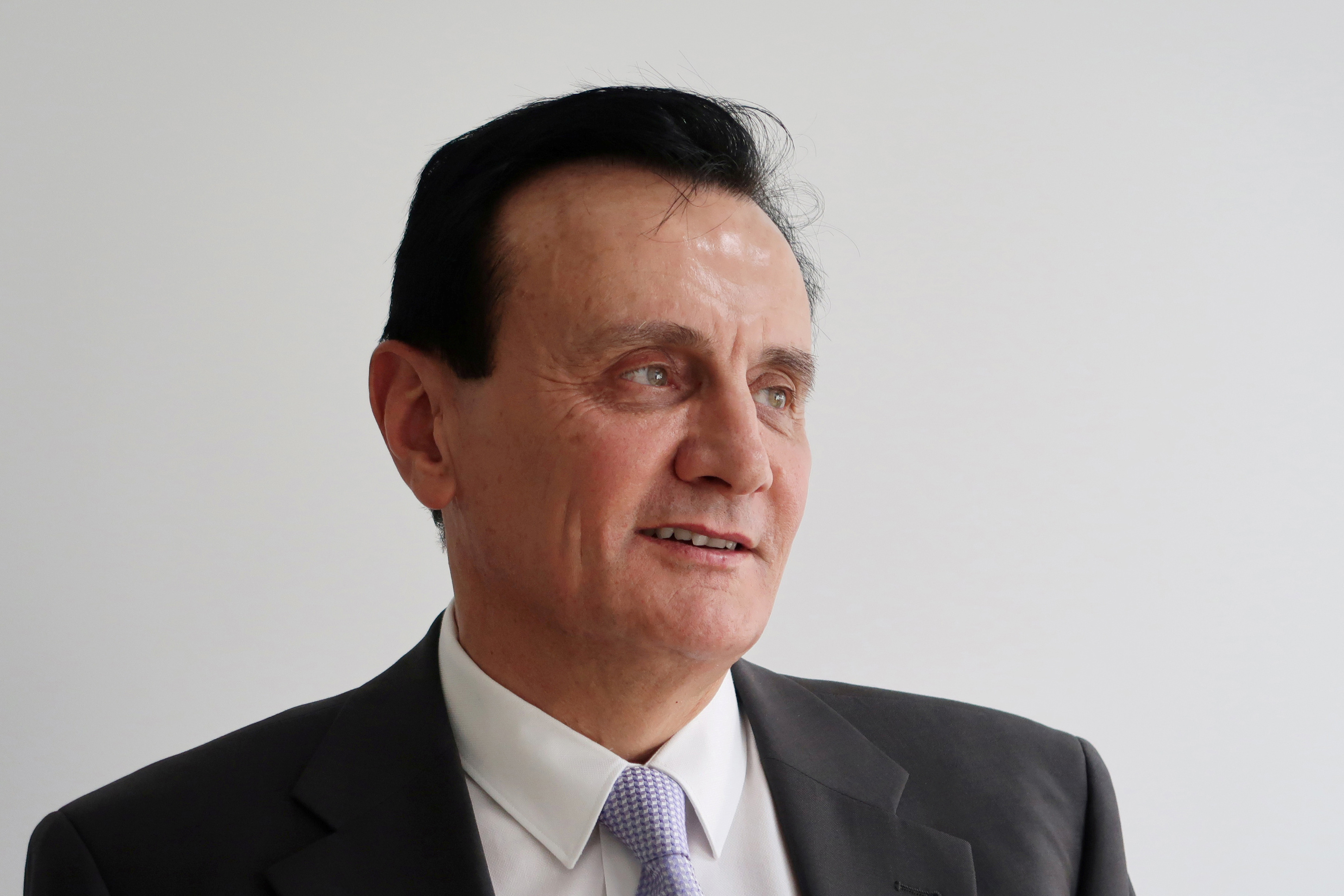 Pascal Soriot, chief executive officer of pharmaceutical company AstraZeneca, attends an interview with Reuters in Shanghai, China November 4, 2019. Picture taken November 4, 2019.  REUTERS/Brenda Goh/File Photo