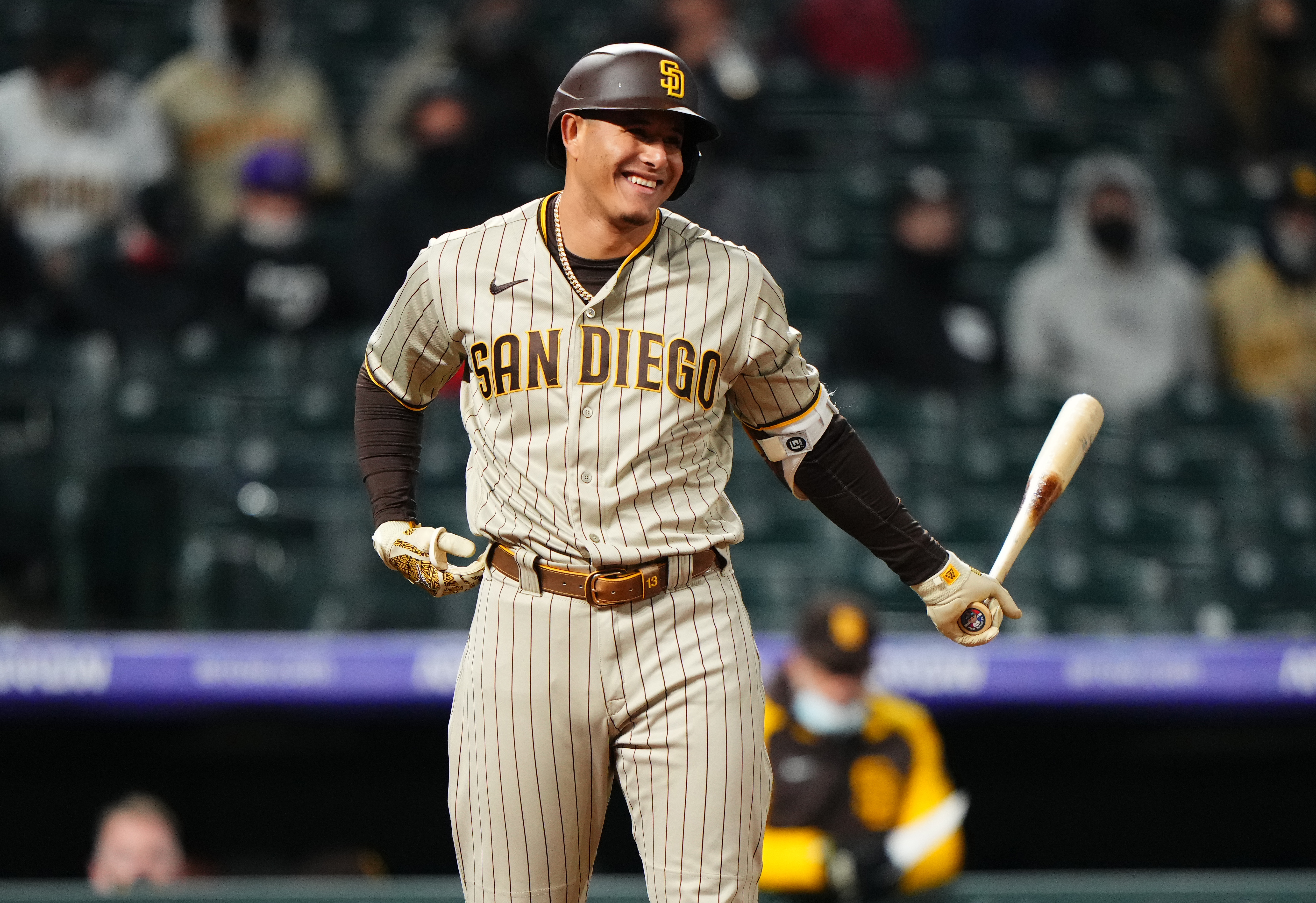 May 11, 2021; Denver, Colorado, USA; San Diego Padres third baseman Manny Machado (13) reacts in the eighth inning against the Colorado Rockies at Coors Field. Mandatory Credit: Ron Chenoy-USA TODAY Sports