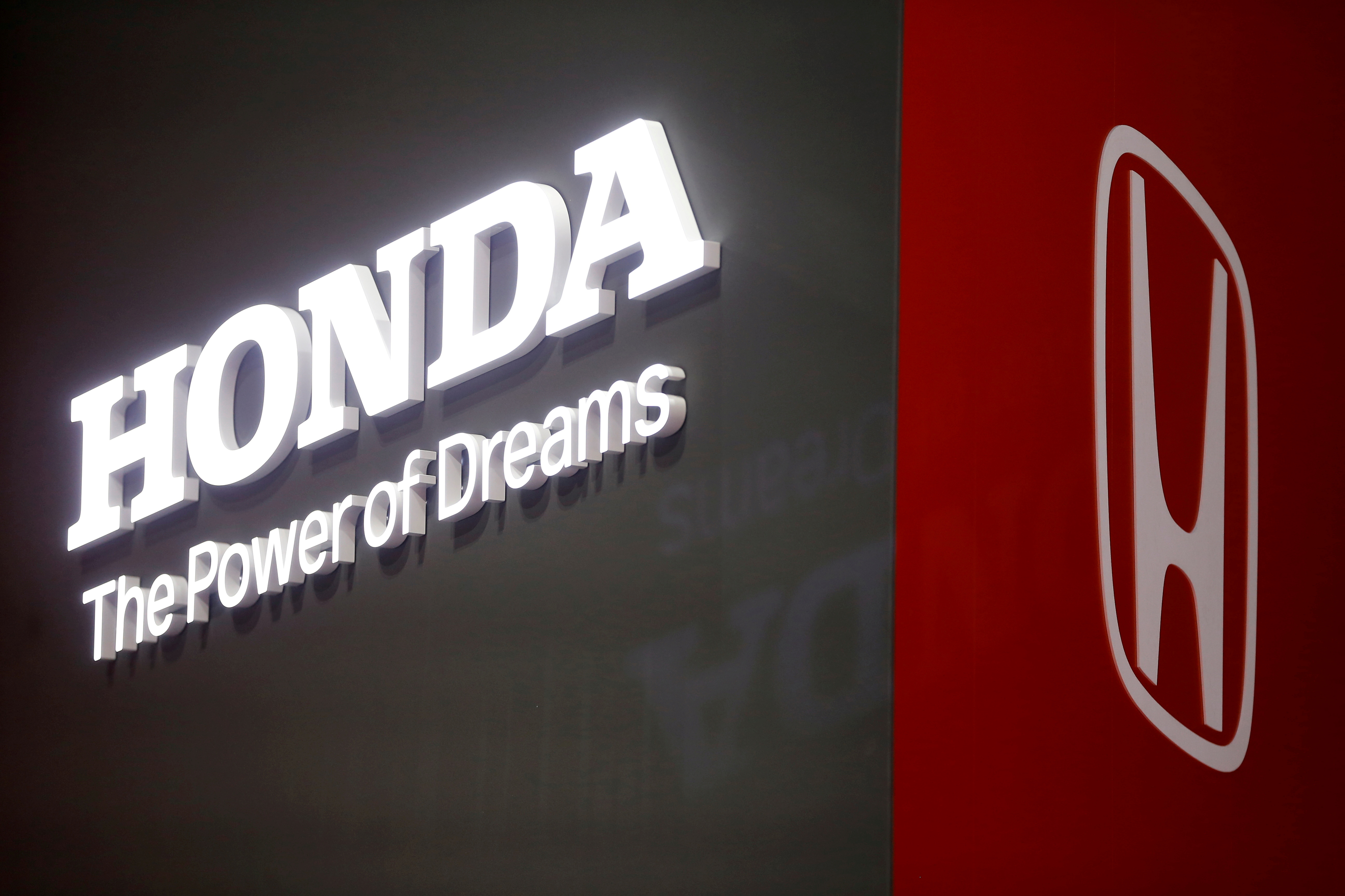 The Honda logo is displayed at the 89th Geneva International Motor Show in Geneva, Switzerland, March 5, 2019. REUTERS/Pierre Albouy/File Photo