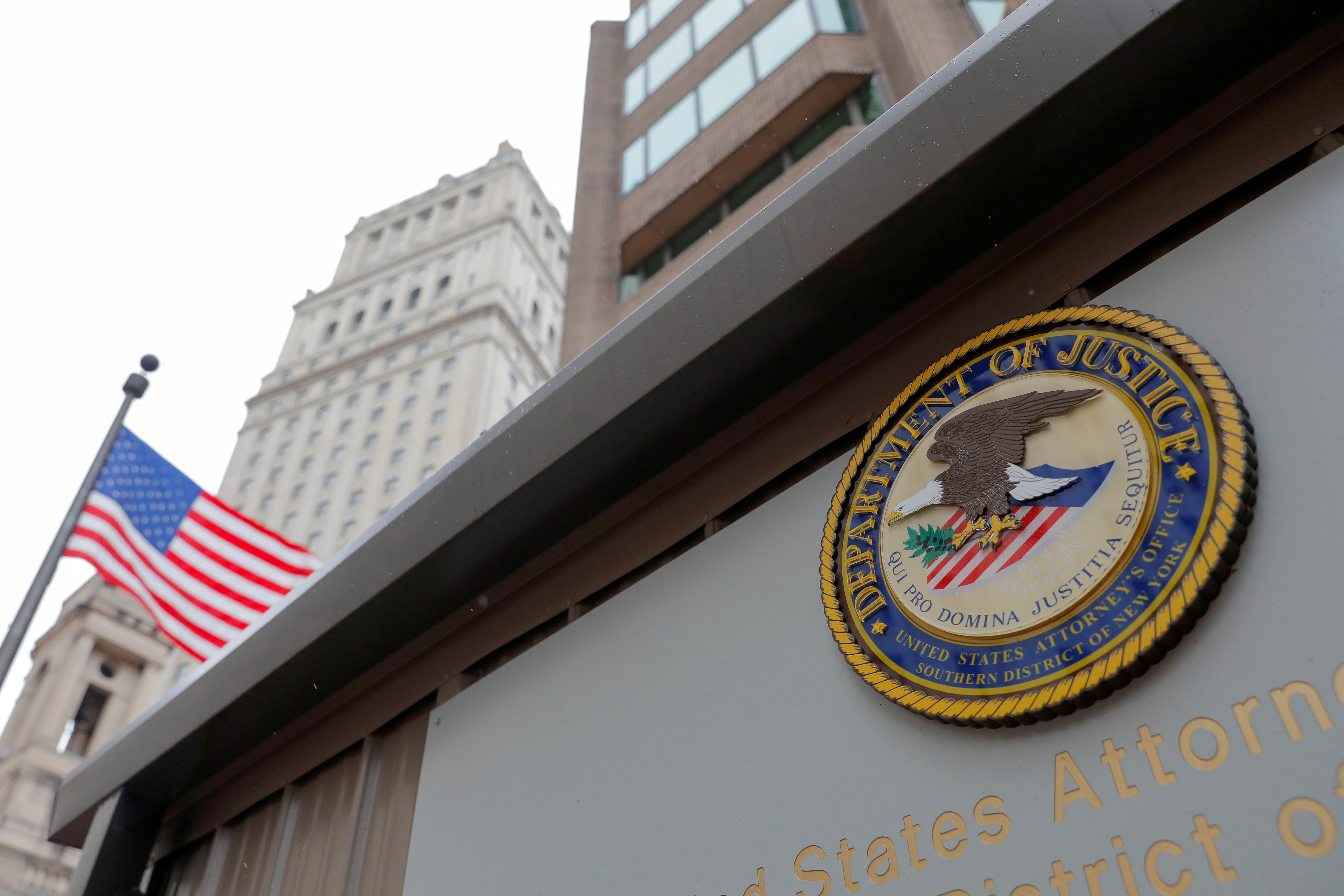 The seal of the United States Department of Justice is seen on the building exterior of the United States Attorney's Office of the Southern District of New York in Manhattan, New York City, U.S., August 17, 2020. REUTERS/Andrew Kelly