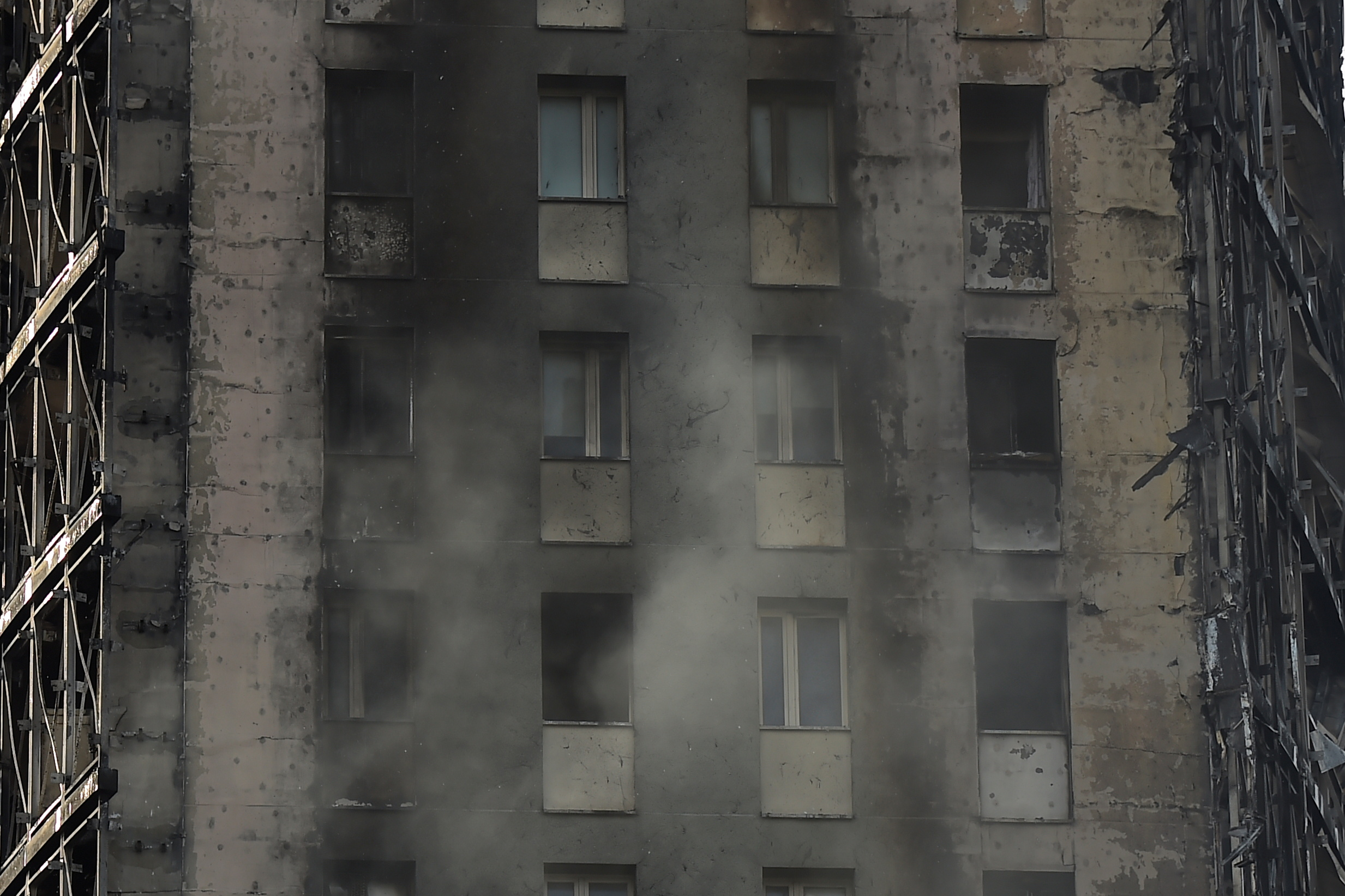 Blackened ruins of a block of flats are seen after a fire ripped through the building, no injuries were reported, in Milan, Italy, August 30, 2021. REUTERS/Flavio Lo Scalzo