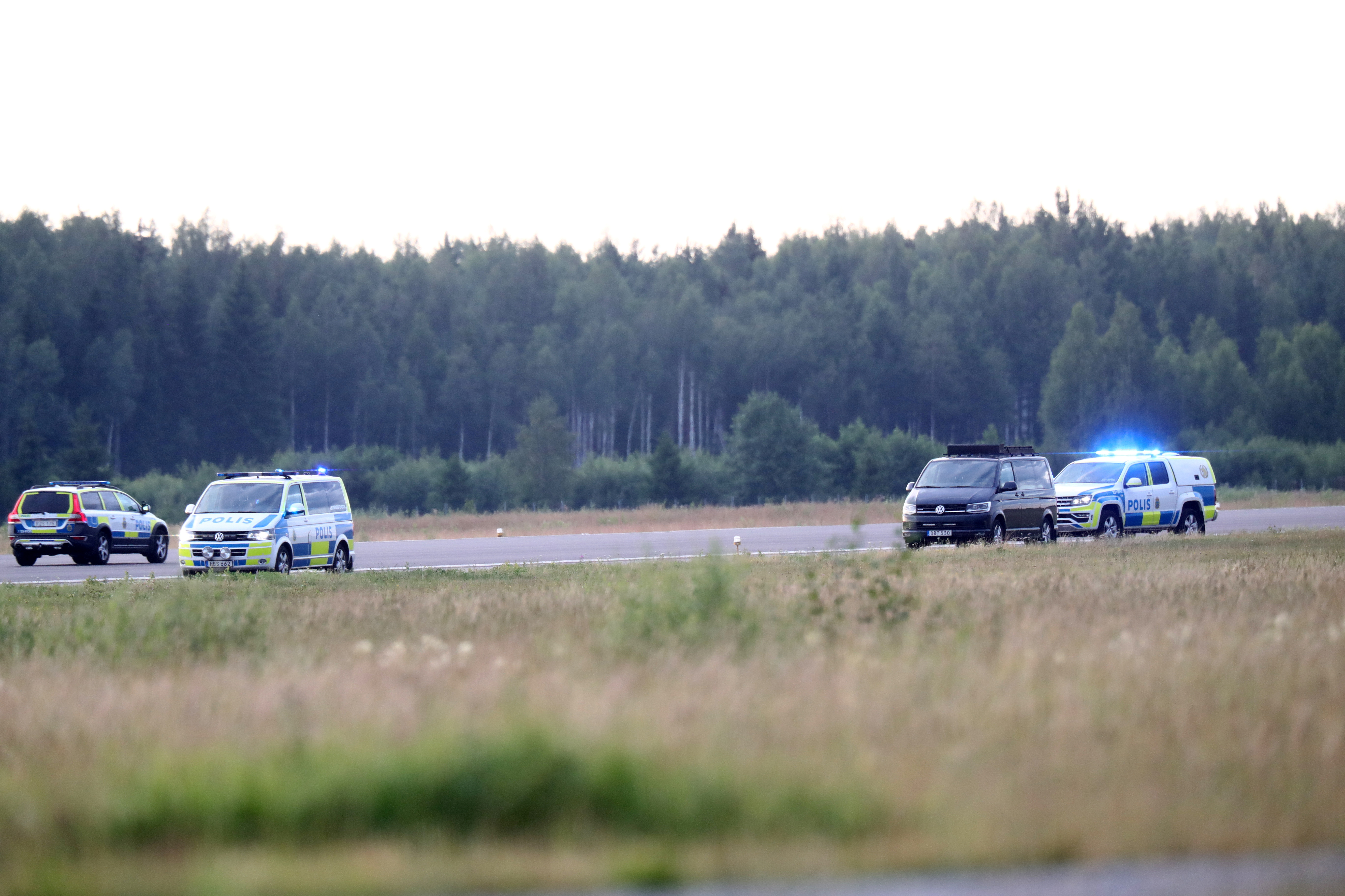 Police cars are seen near the site where a small aircraft has crashed in Orebro, Sweden,  July 8 2021.  TT News Agency/Jeppe Gustafsson via REUTERS