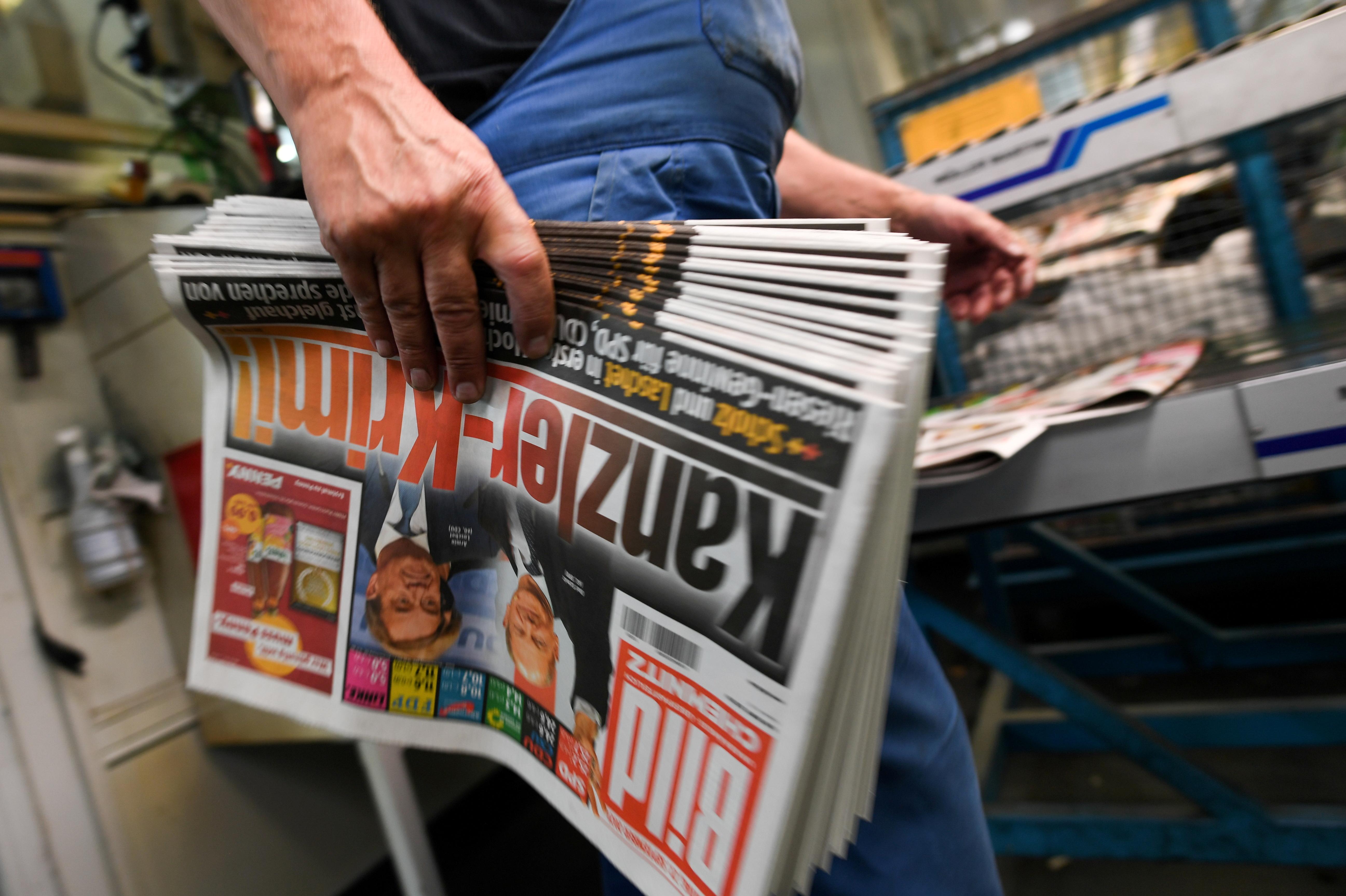 Germany's Axel Springer fires top Bild editor after media report