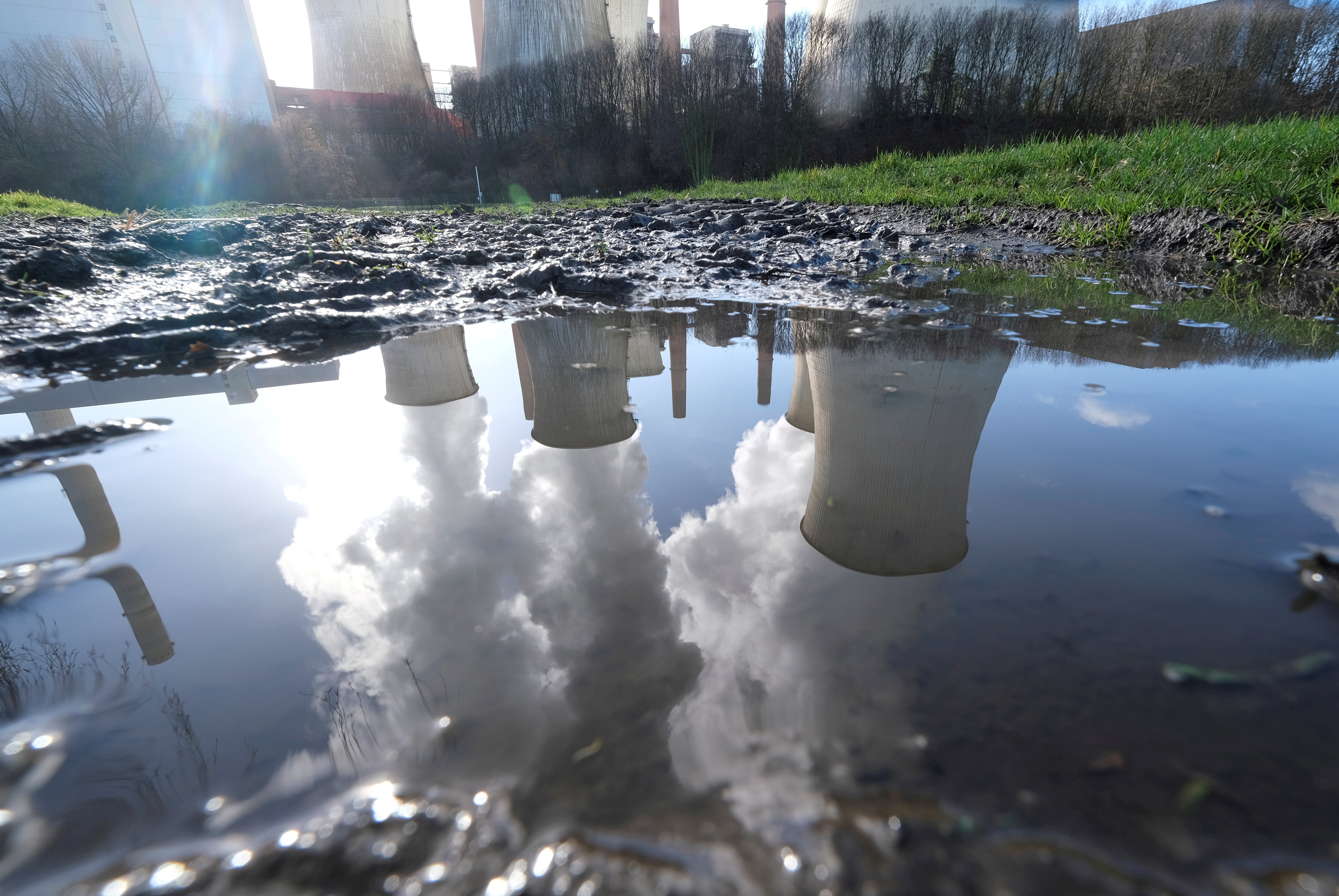 The lignite (brown coal) power plant complex of German energy supplier and utility RWE is reflected in a puddle in Neurath, north-west of Cologne, Germany, February 5, 2020.    REUTERS/Wolfgang Rattay//File Photo