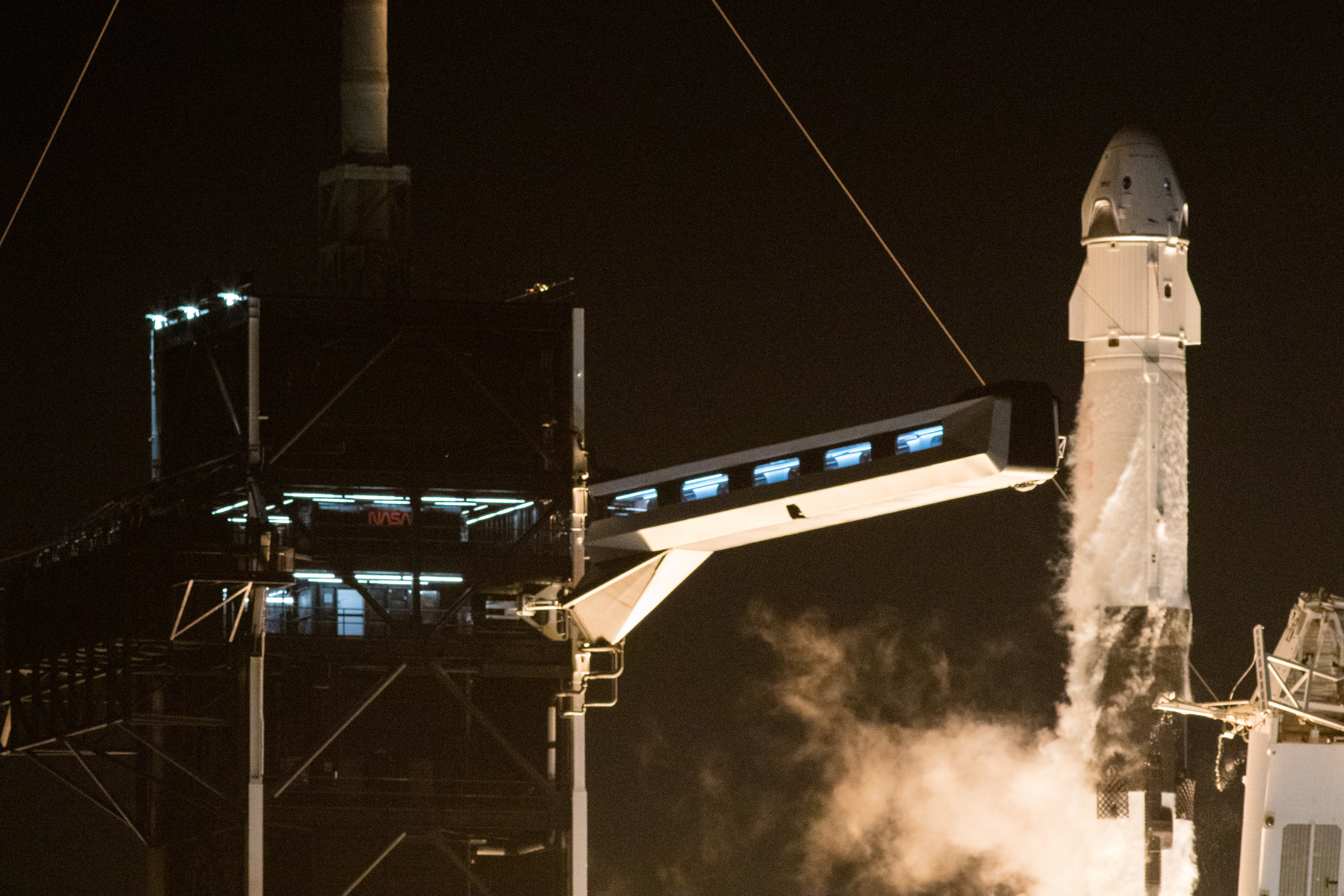 A SpaceX Falcon 9 rocket, topped with the Crew Dragon capsule, is launched carrying four astronauts on the first operational NASA commercial crew mission at Kennedy Space Center in Cape Canaveral, Florida, U.S. November 15, 2020. NASA/Joel Kowsky/Handout via REUTERS