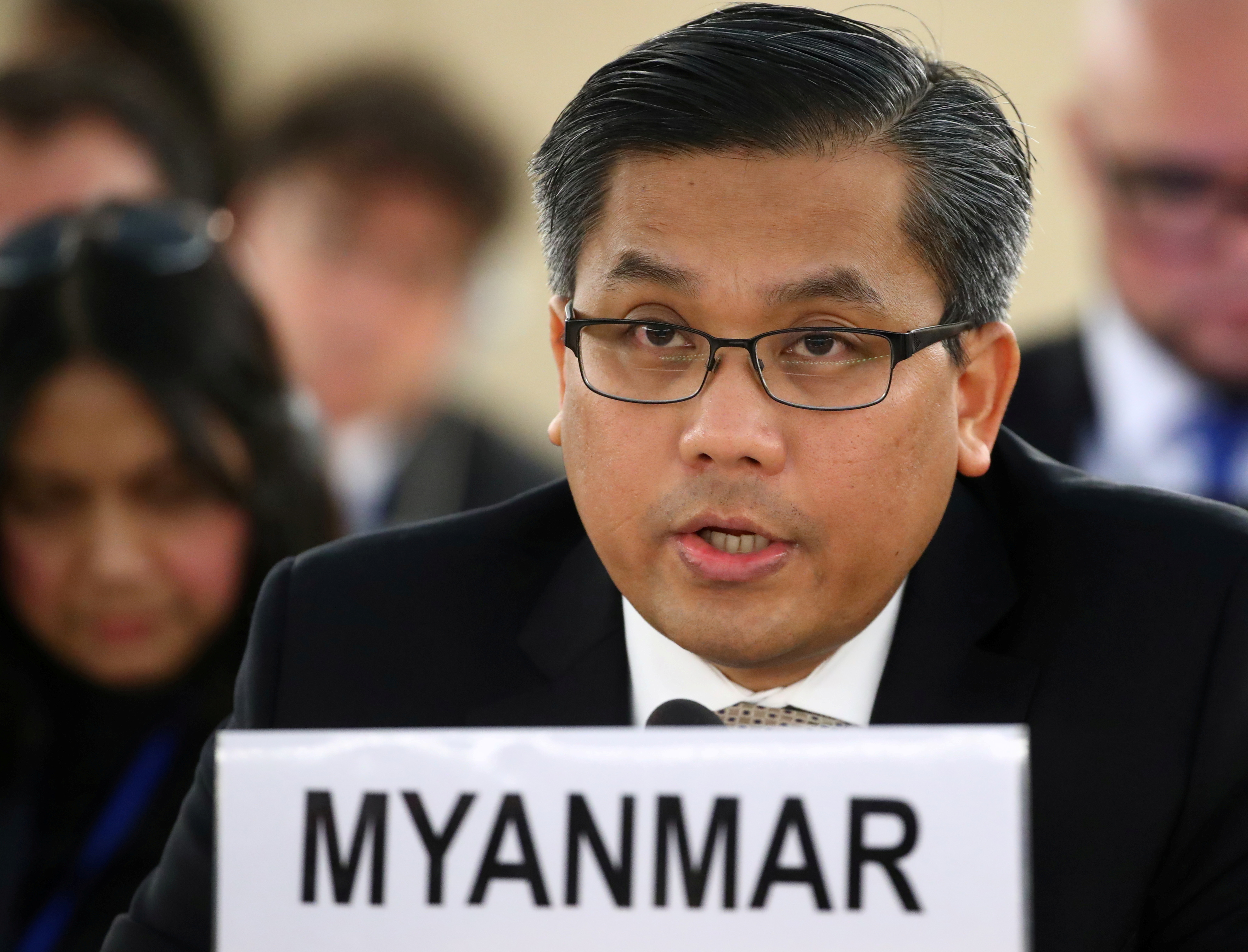 Myanmar's ambassador Kyaw Moe Tun addresses the Human Rights Council at the United Nations in Geneva, Switzerland, March 11, 2019. REUTERS/Denis Balibouse/File Photo