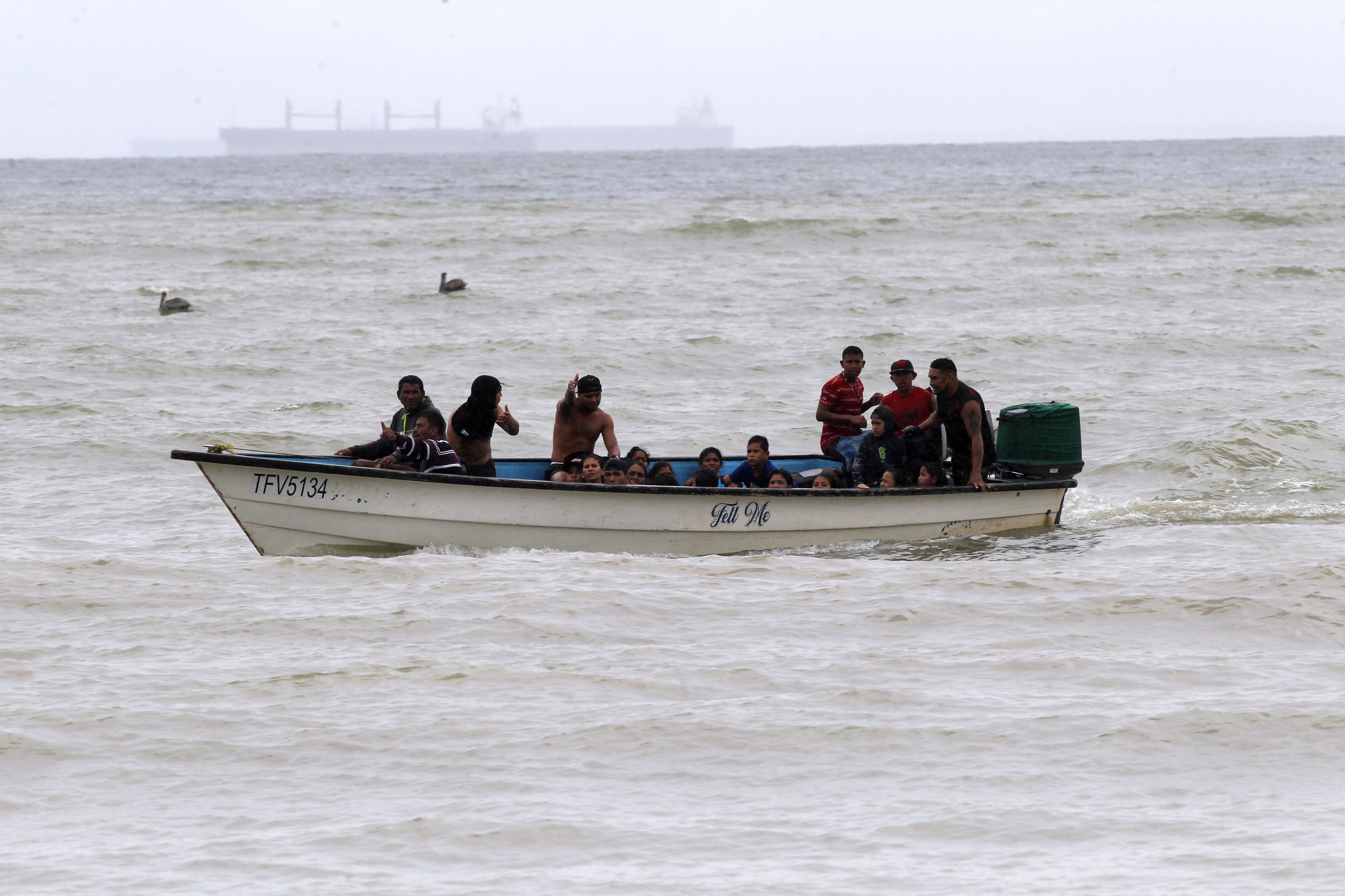 Venezuelan migrants, who were recently deported, arrive at shore on Los Iros Beach after their return to the island, in Erin, Trinidad and Tobago, November 24, 2020. Lincoln Holder/Courtesy Newsday/Handout via REUTERS