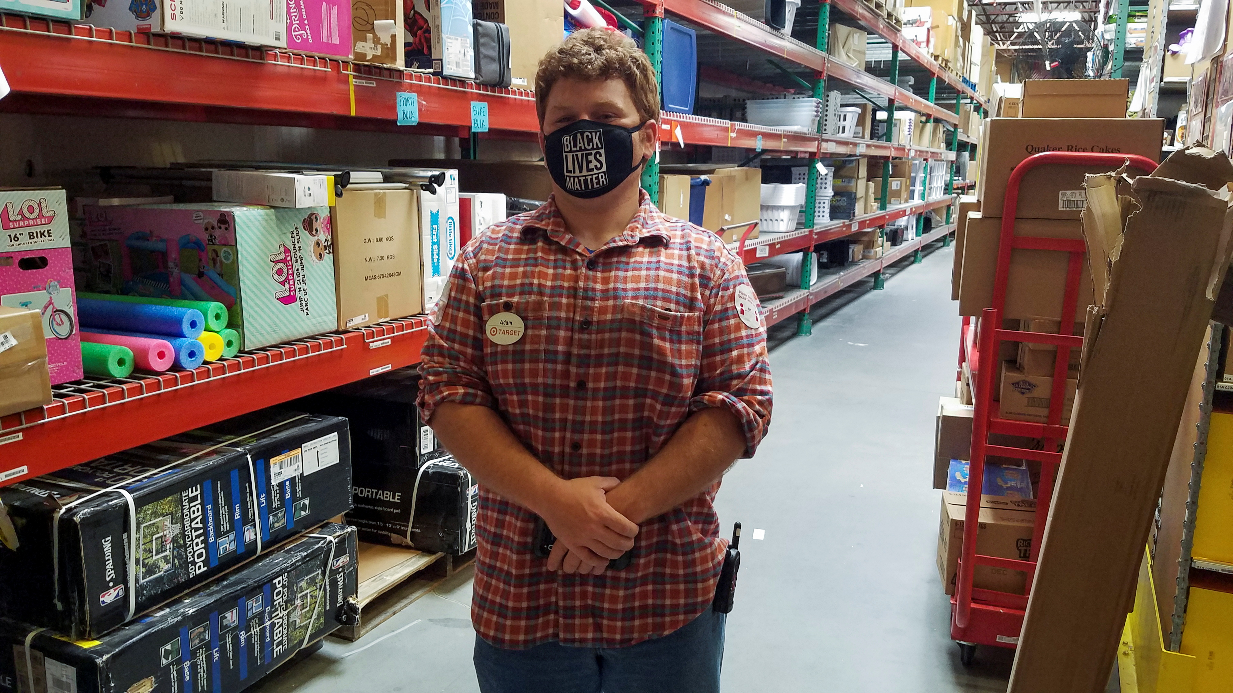Target worker Adam Ryan stands in the stockroom of his store in Christiansburg, Virginia, U.S. May 10, 2021. Adam Ryan/Handout via REUTERS