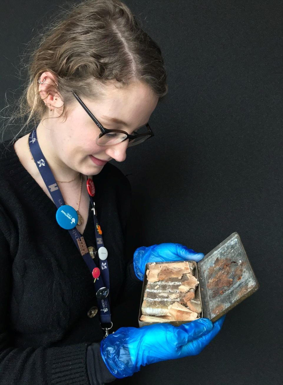 Katherine Bridges, Senior House and Collections Officer at the National Trust, holds a 121-year-old tin of chocolate from a batch commissioned by Queen Victoria for British troops fighting in South Africa, in an undated photo at Oxburgh Hall, a manor house in Norfolk, Britain where it was found in the attic. National Trust/Victoria Mckeown/Handout via REUTERS  THIS IMAGE HAS BEEN SUPPLIED BY A THIRD PARTY. MANDATORY CREDIT. NO RESALES. NO ARCHIVES