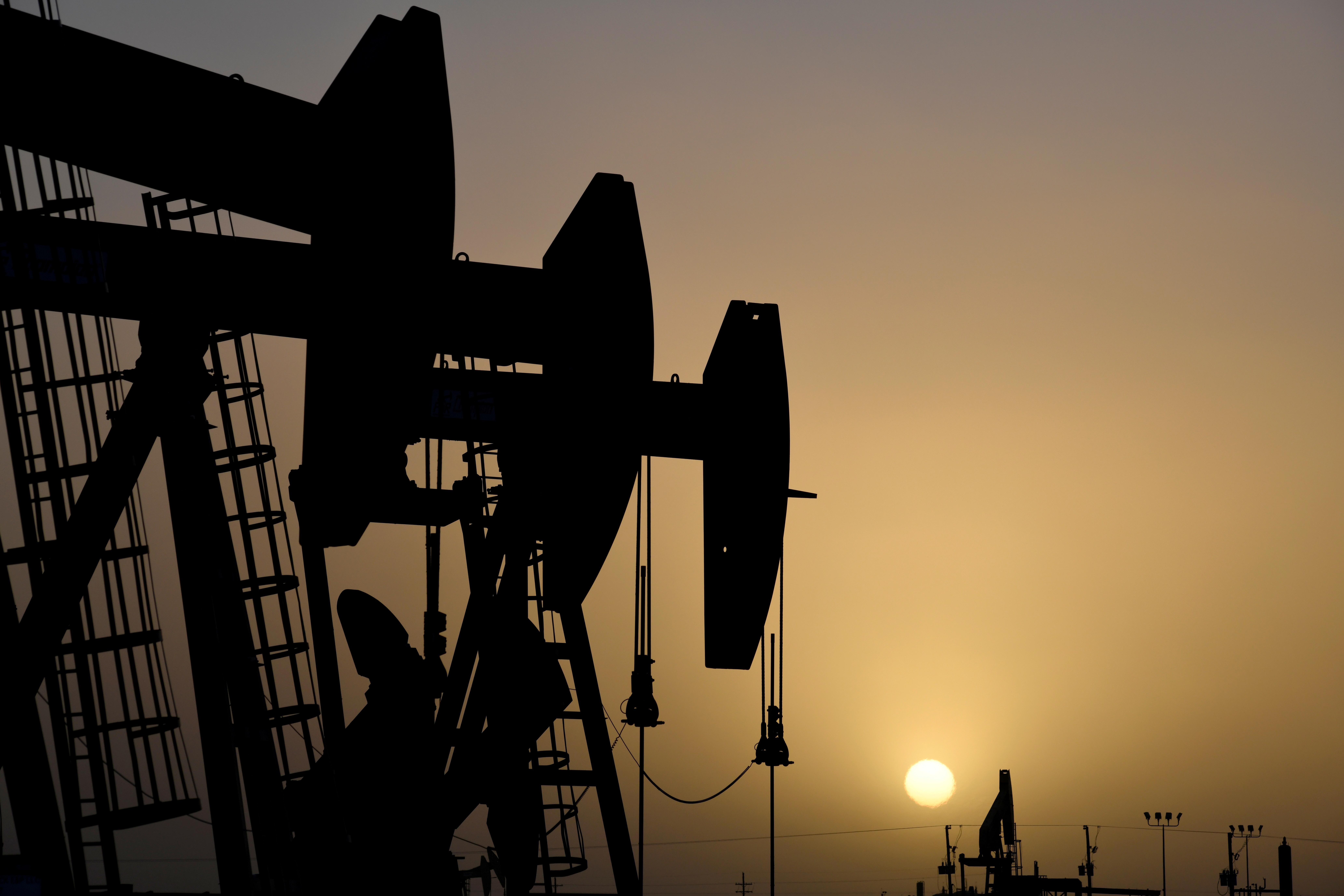 Pump jacks operate at sunset in Midland, Texas, U.S., February 11, 2019. REUTERS/Nick Oxford