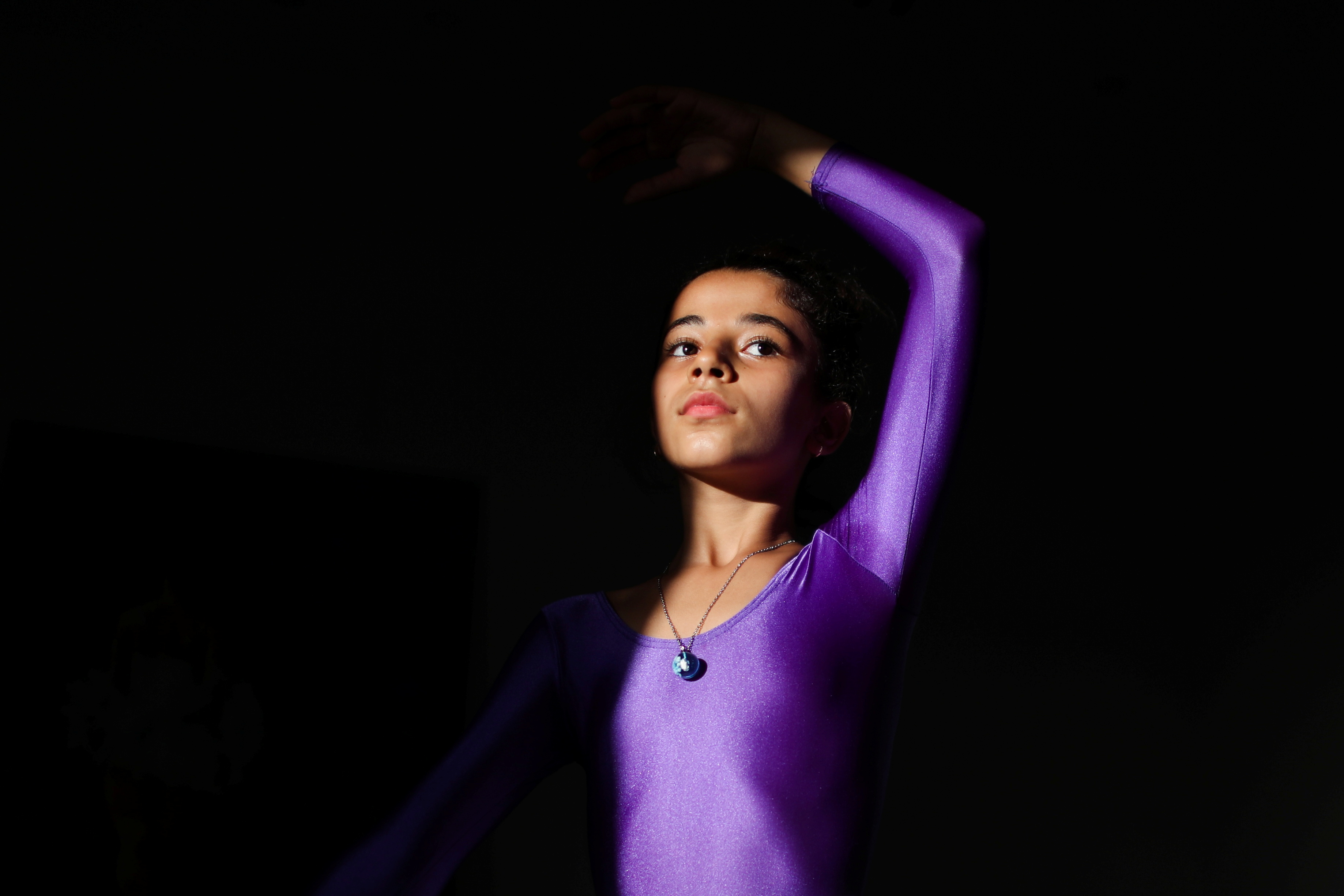 A Palestinian Maya Harb takes part in ballet dancing at her home in Gaza City, September 8, 2021.REUTERS/Mohammed Salem