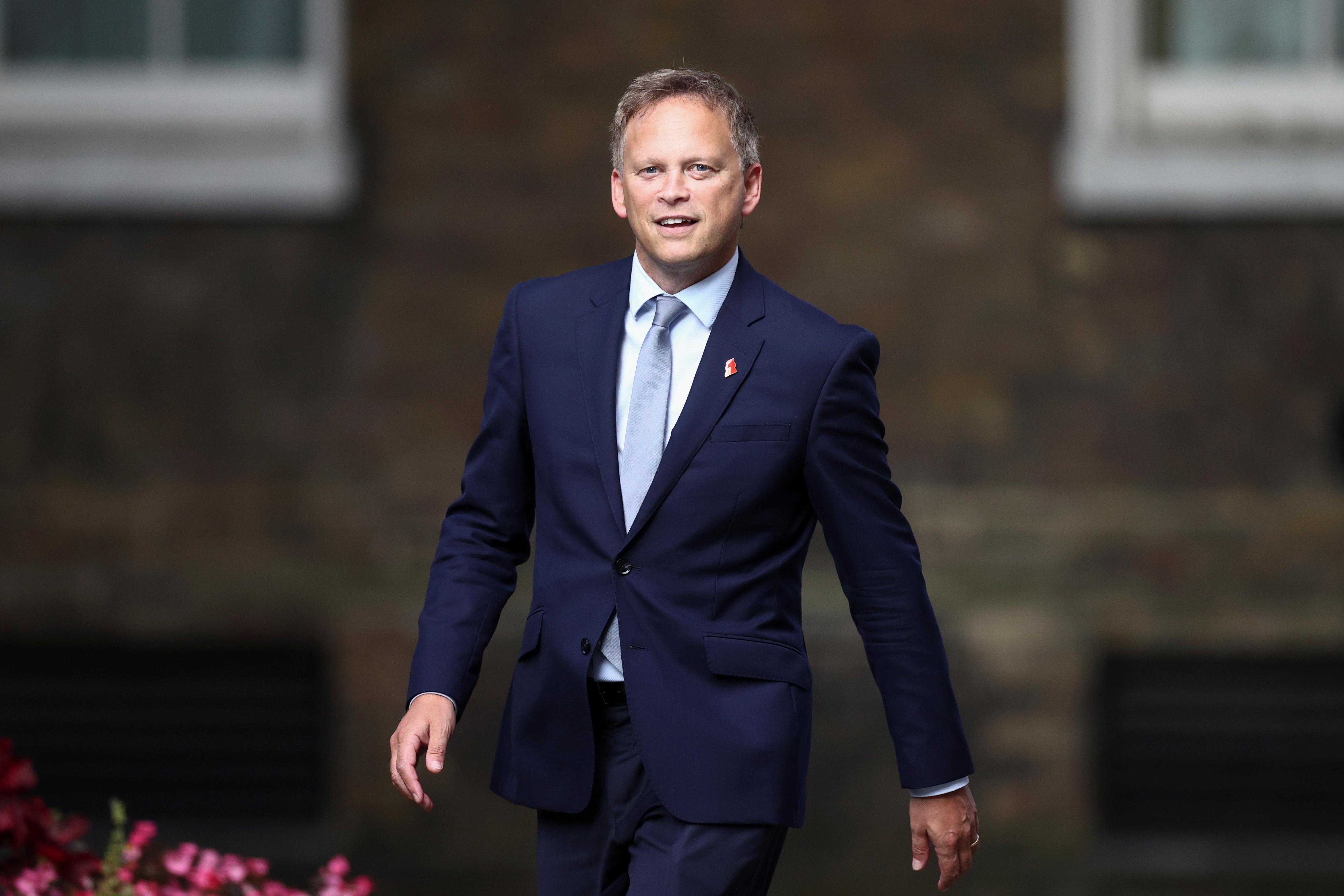 Britain's Transport Secretary Grant Shapps walks outside Downing Street in London, Britain, September 15, 2021. REUTERS/Hannah McKay