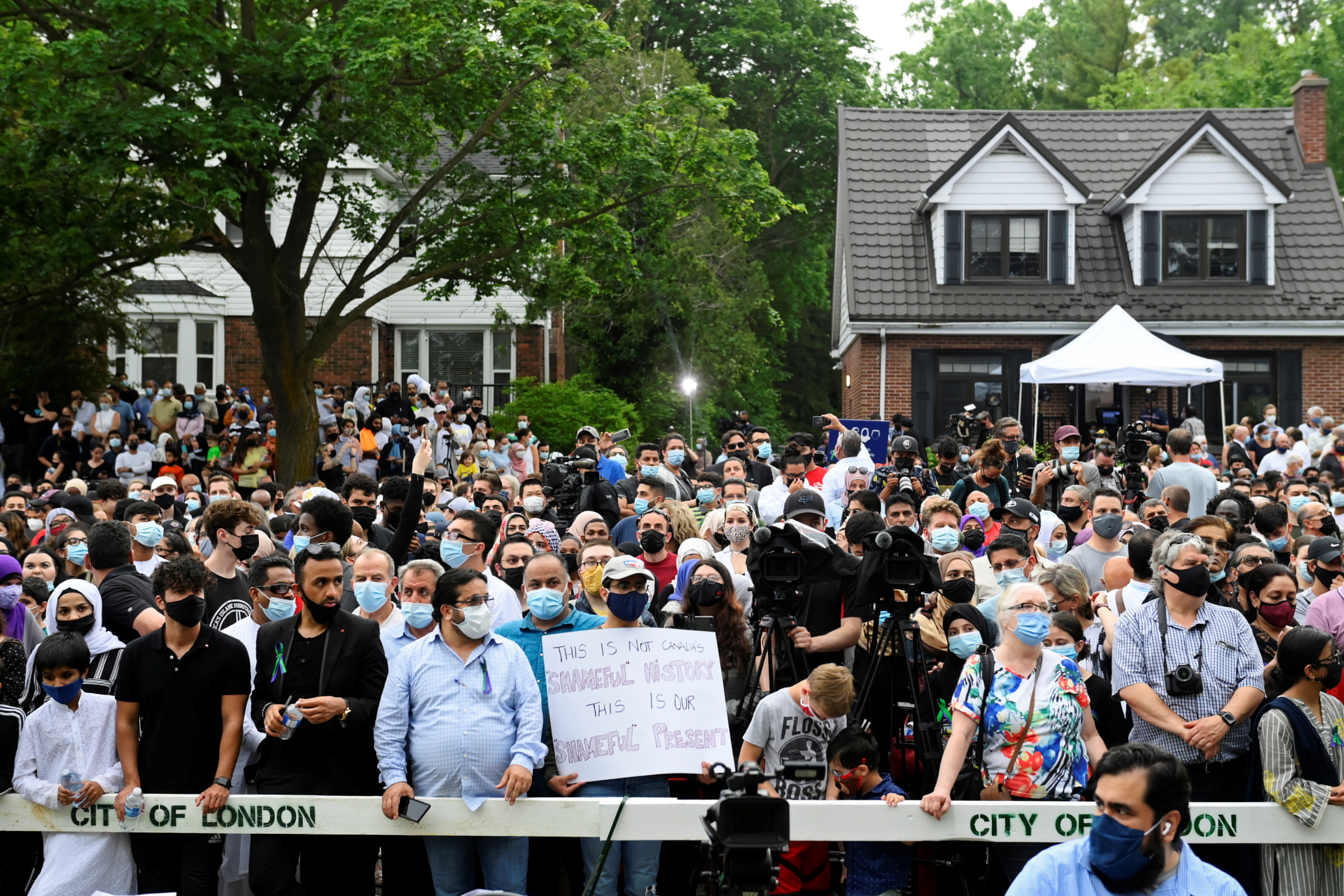 People attend a vigil outside the London Muslim Mosque organized after four members of a Canadian Muslim family were killed in what police describe as a hate-motivated attack in London, Ontario, Canada, June 8, 2021. Nathan Denette/Pool via REUTERS