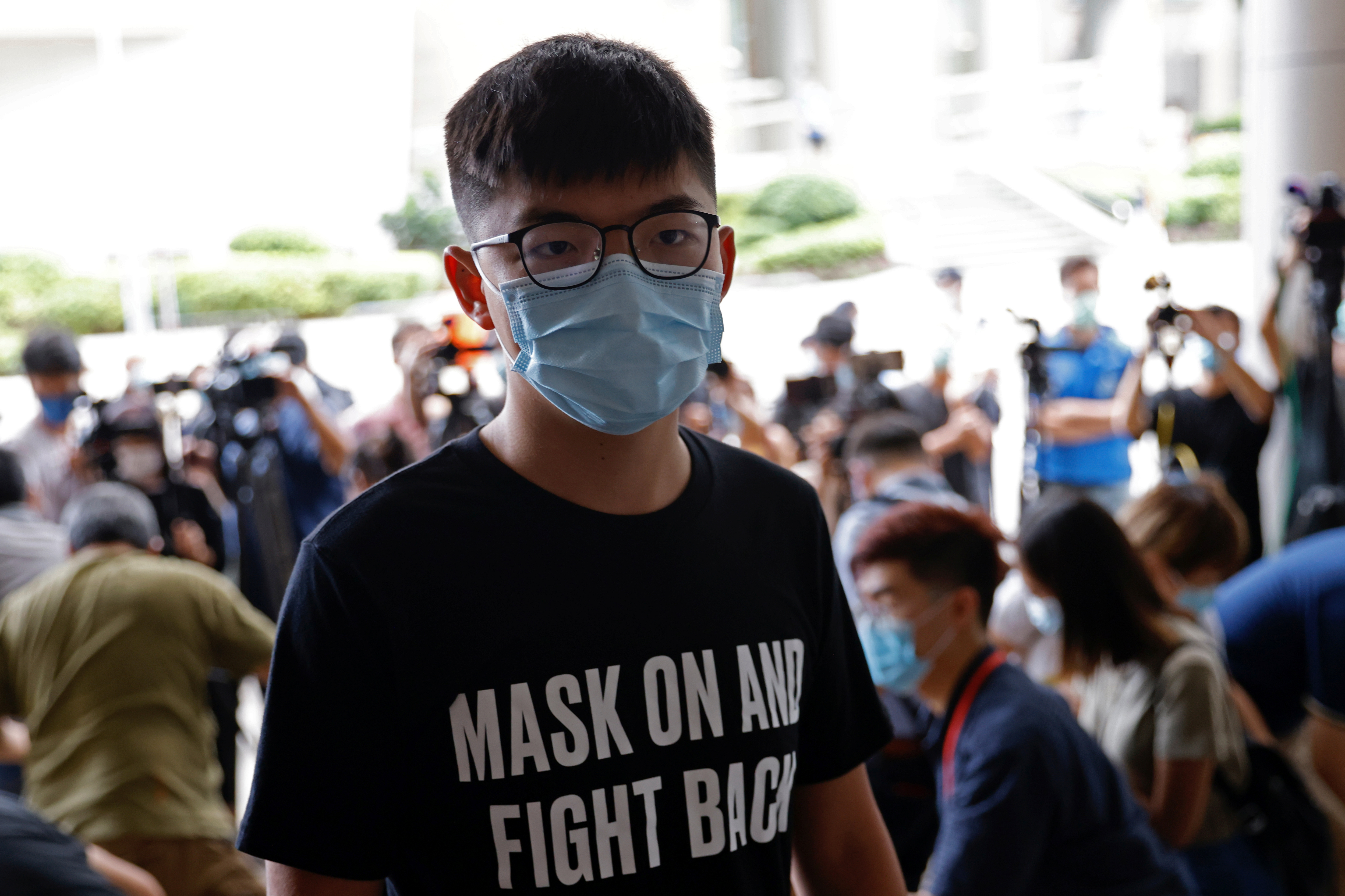 Pro-democracy activist Joshua Wong arrives at the Eastern Magistrates' Courts over illegal assembly and violation of an emergency law banning face coverings last year, in Hong Kong, China September 30, 2020. REUTERS/Tyrone Siu