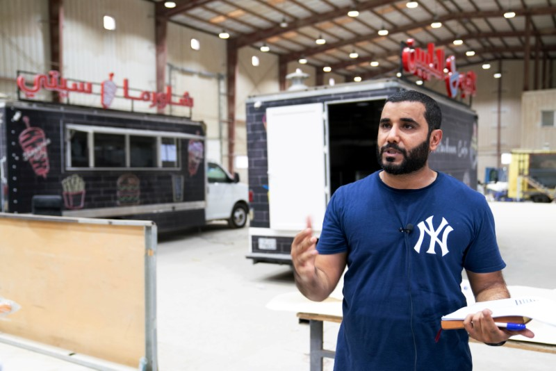 Mohammed al-Blushi speaks at his factory for manufacturing food trucks in Kuwait, July 26, 2021. REUTERS/Stephanie McGehee