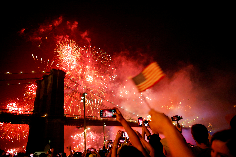 People watch the Macy's 4th of July Firework Show over the Brooklyn Bridge in New York, U.S., July 4, 2019. REUTERS/Eduardo Munoz