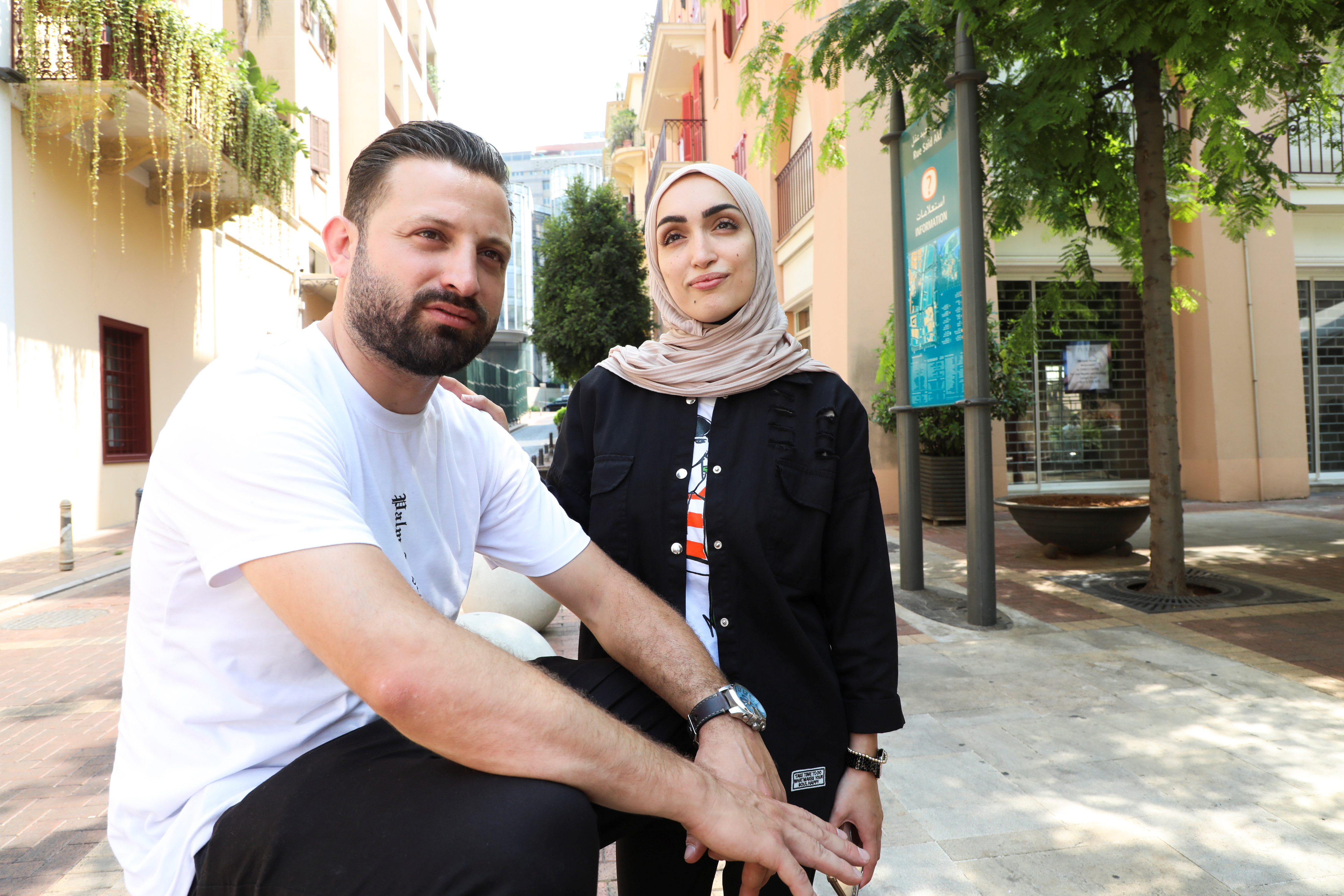 Israa Seblani, a Lebanese doctor and the bride who was caught up in the last year's Beirut port blast during a wedding photoshoot, poses for a picture with her husband Ahmad Subeih, at the same square where they were for their photoshoot in the moment of August 4 explosion, in Beirut, Lebanon July 24, 2021. Picture taken July 24, 2021. REUTERS/Mohamed Azakir