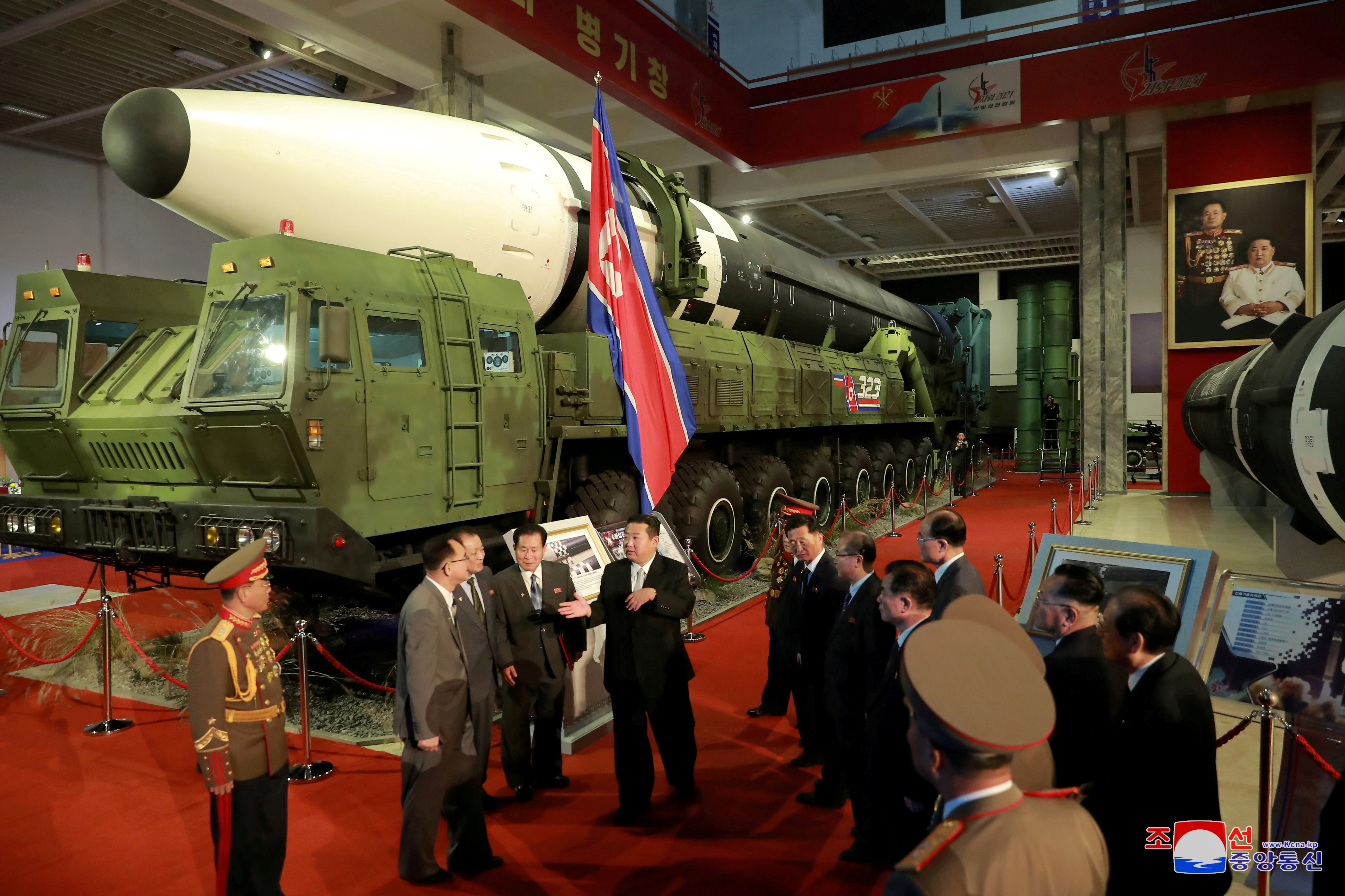 North Korea's leader Kim Jong Un speaks to officials next to military weapons and vehicles on display, including the country's intercontinental ballistic missiles (ICBMs), at the Defence Development Exhibition, in Pyongyang, North Korea, October 12.  KCNA via REUTERS