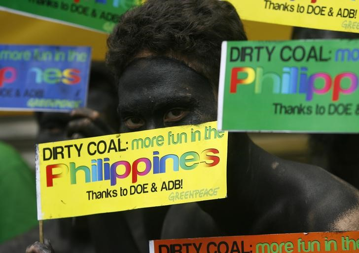 File photo: An environmentalist, covered in black paint, protests against coal projects and call on the government to implement renewable energy solutions during the 7th Asia Clean Energy Forum at the Asian Development Bank (ADB) in Mandaluyong City, Metro Manila June 7, 2012. REUTERS/Cheryl Ravelo