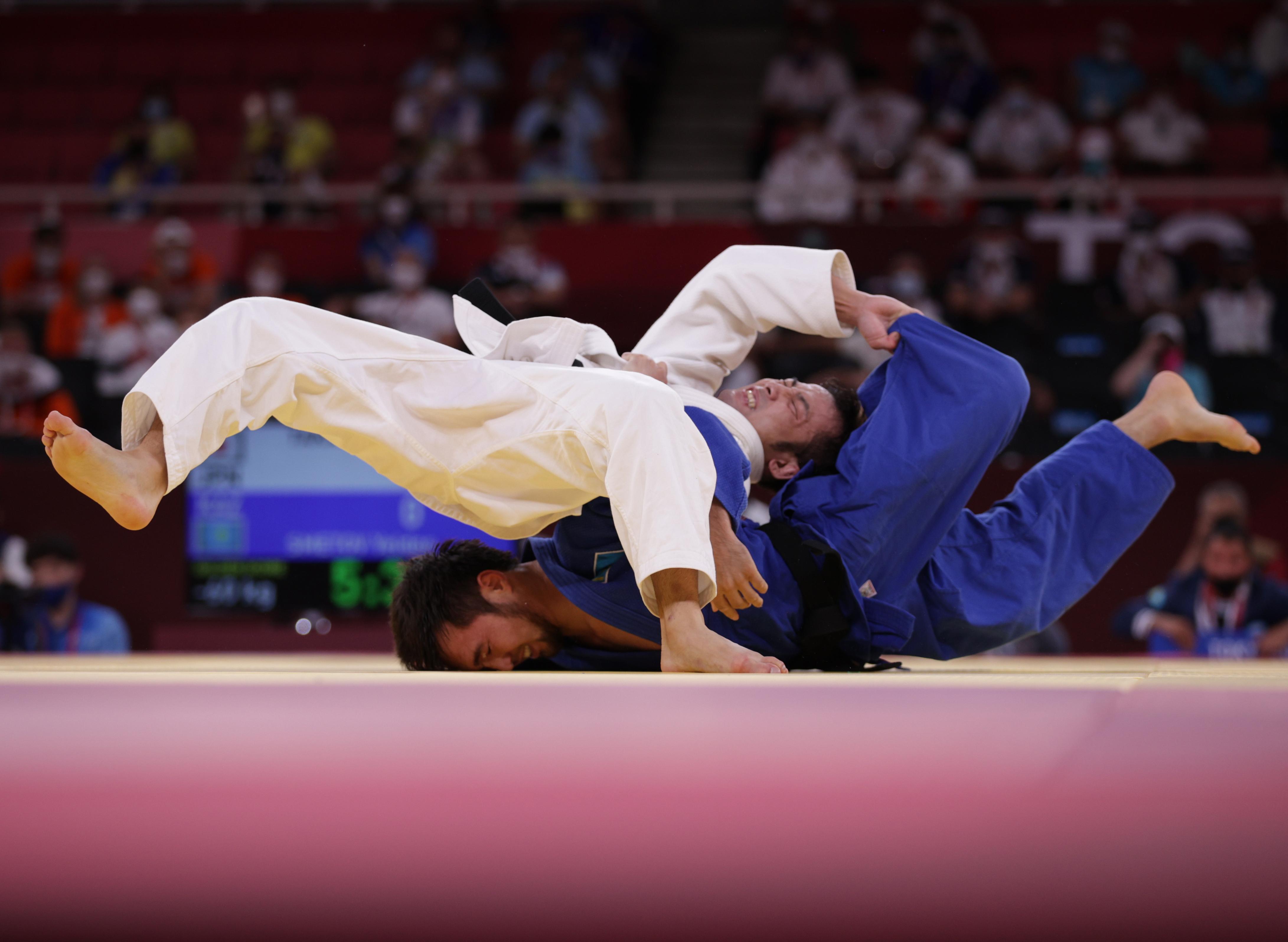 Tokyo 2020 Olympics - Judo - Men's 60kg - Semifinal - Nippon Budokan - Tokyo, Japan - July 24, 2021. Naohisa Takato of Japan in action against Yeldos Smetov of Kazakhstan REUTERS/Hannah Mckay