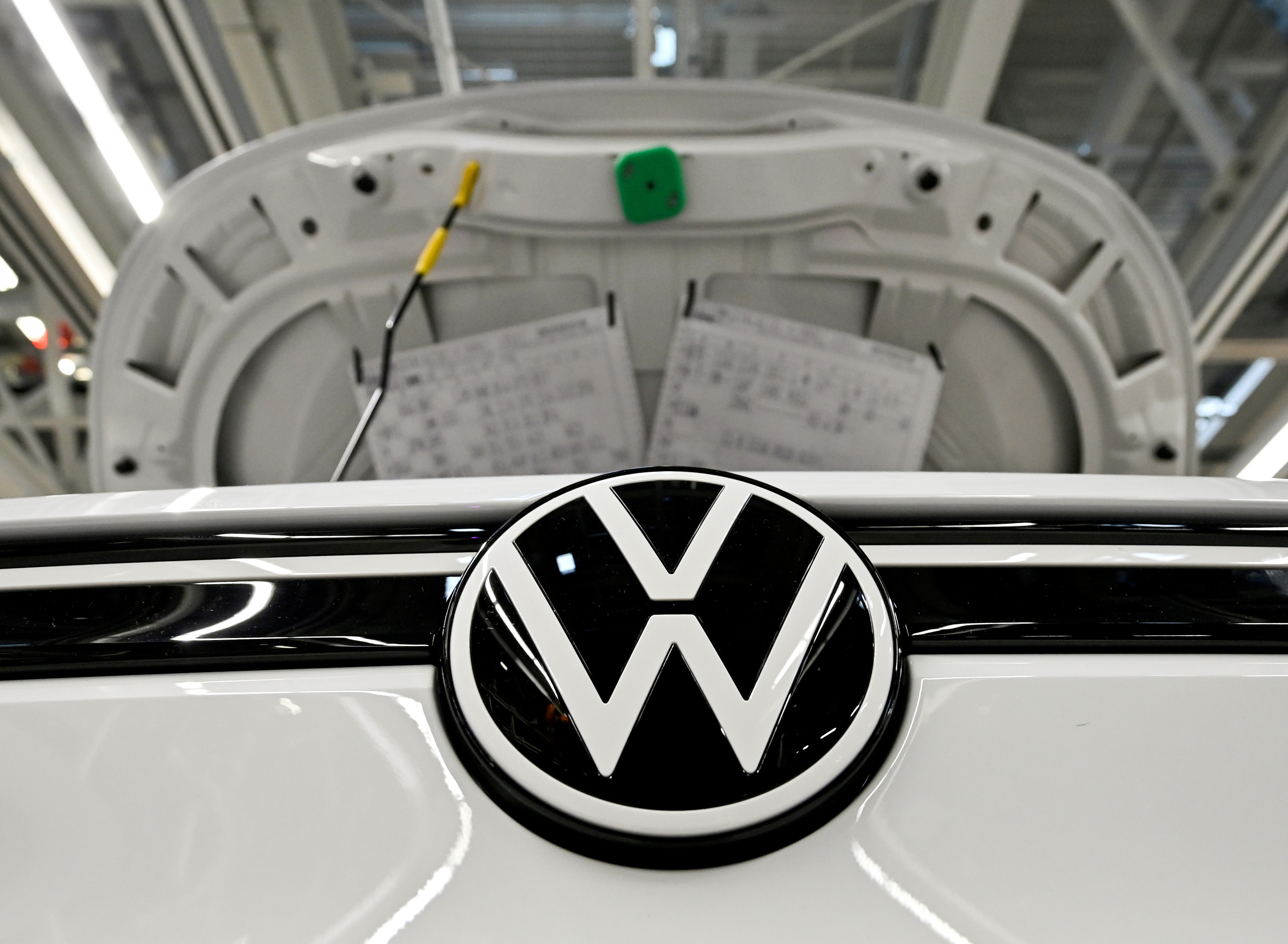 A car stands at the production line for the electric Volkswagen cars, model ID.3 and model ID. 4, in Zwickau, Germany, September 18, 2020. REUTERS/Matthias Rietschel