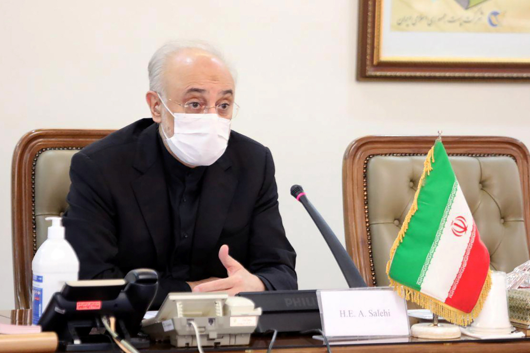 Head of Iran's Atomic Energy Organization Ali-Akbar Salehi wears a  mask as he speaks during a meeting with International Atomic Energy Agency (IAEA) Director General Rafael Grossi, in Tehran, Iran August 25, 2020. WANA (West Asia News Agency) via REUTERS