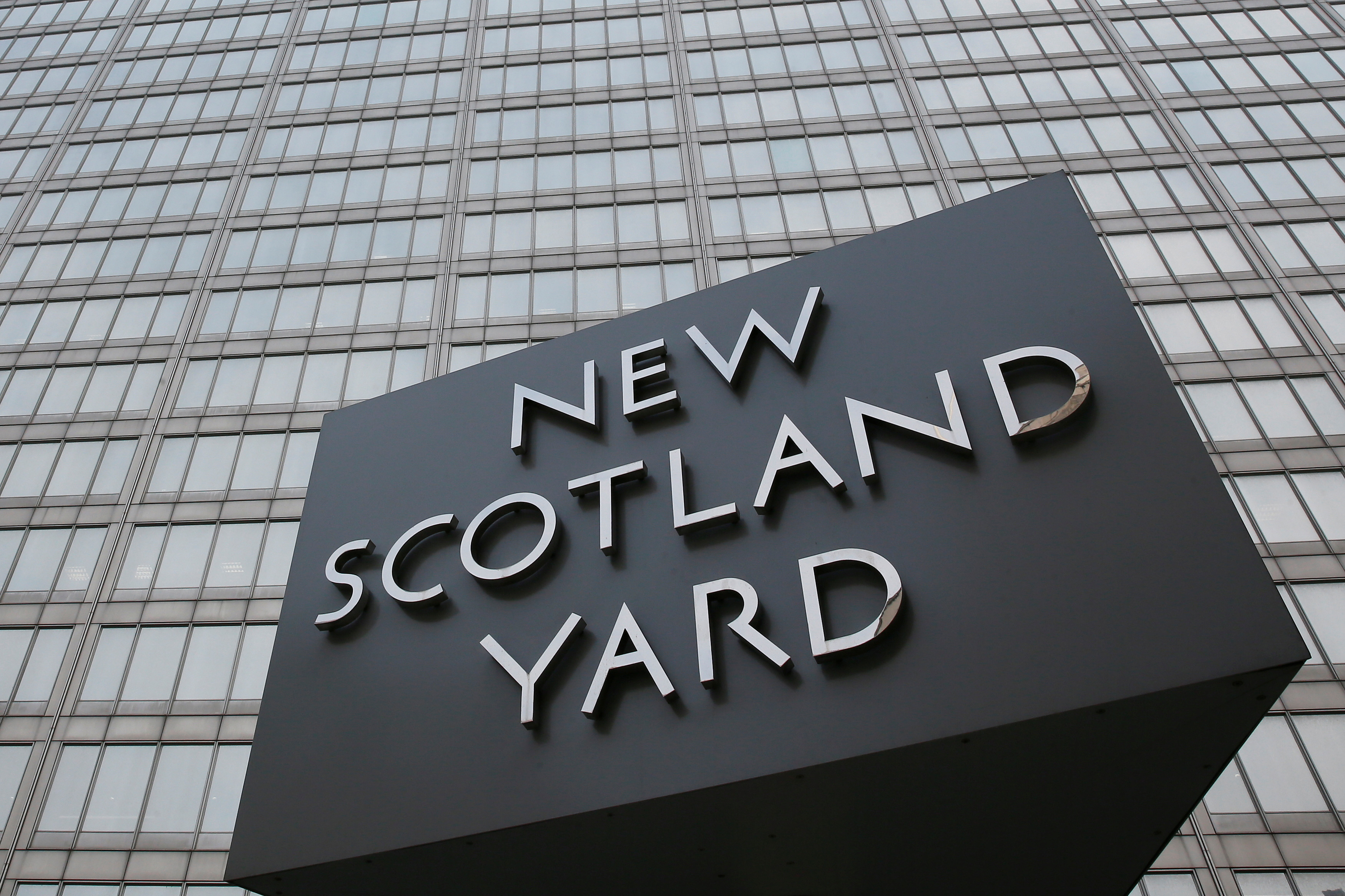 The rotating triangular sign is seen outside New Scotland Yard in central London March 17, 2015. REUTERS/Stefan Wermuth