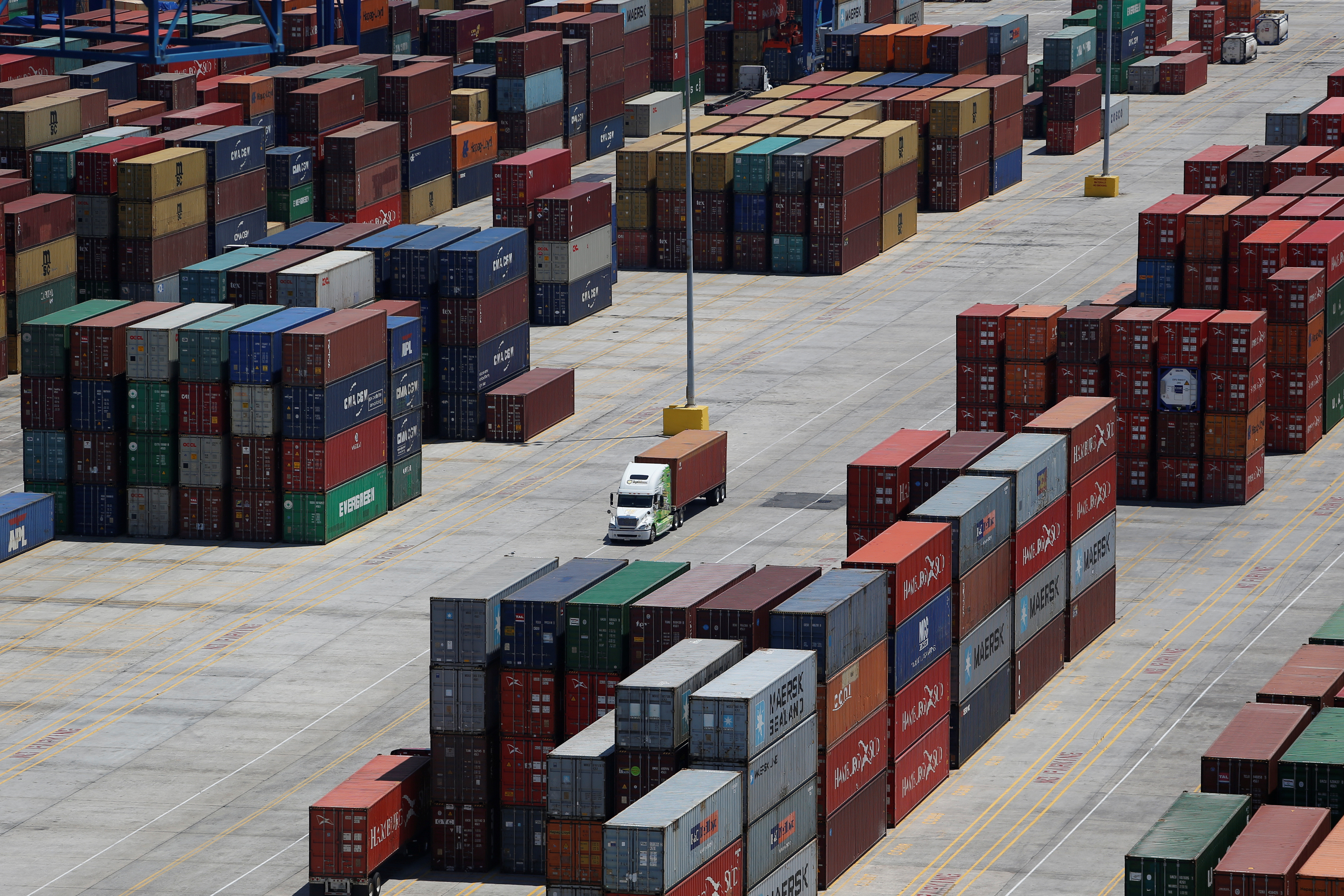 Shipping containers are stacked for storage at Wando Welch Terminal operated by the South Carolina Ports Authority in Mount Pleasant, South Carolina, U.S. May 10, 2018. Picture taken May 10, 2018. REUTERS/Randall Hill