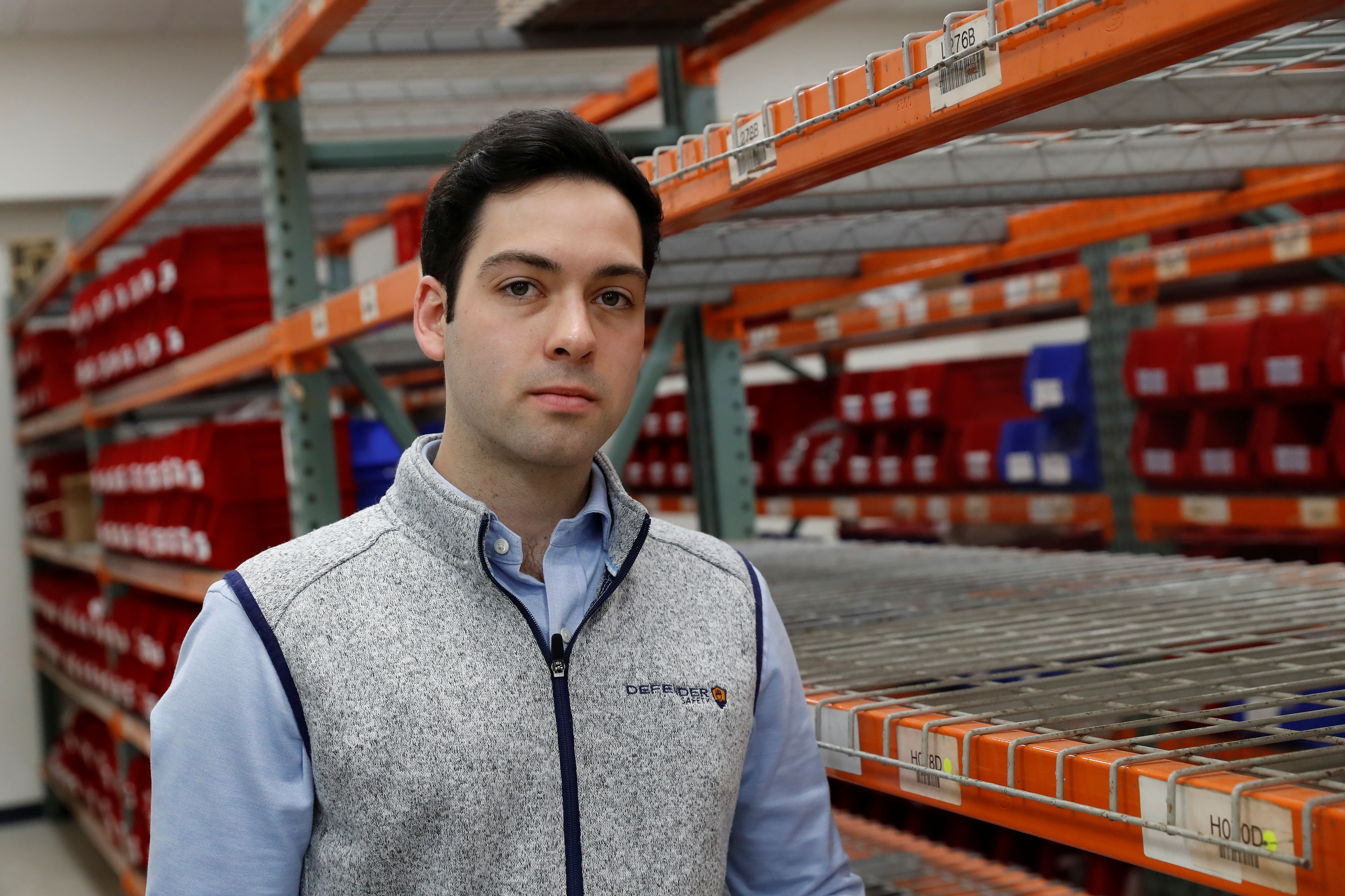 Teddy Haggerty, CEO and Founder of Defender Safety, stands inside his warehouse in Plainview, New York, U.S., March 24, 2021. REUTERS/Shannon Stapleton