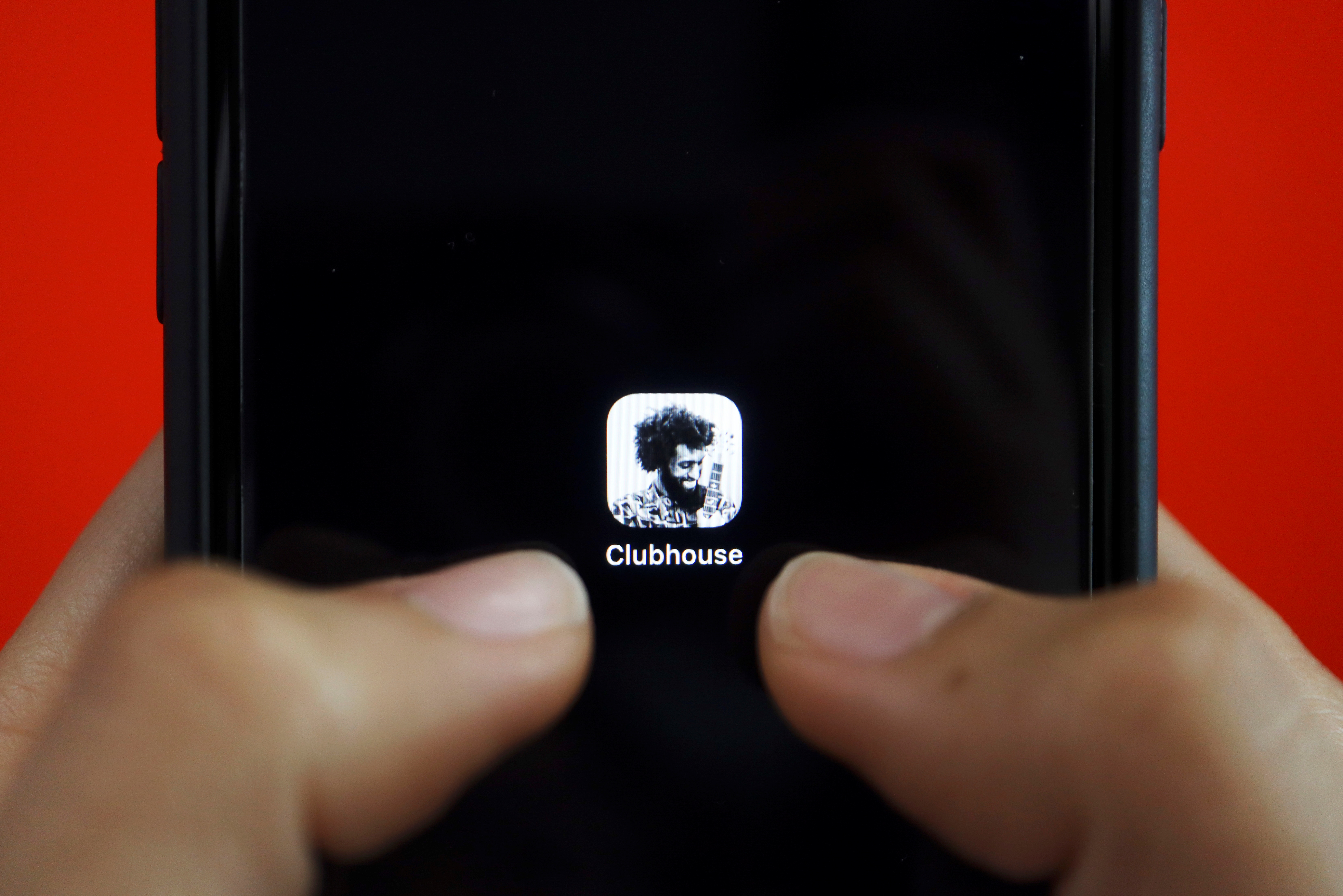 The social audio app Clubhouse is seen on a mobile phone in this illustration picture taken February 8, 2021. REUTERS/Florence Lo/Illustration