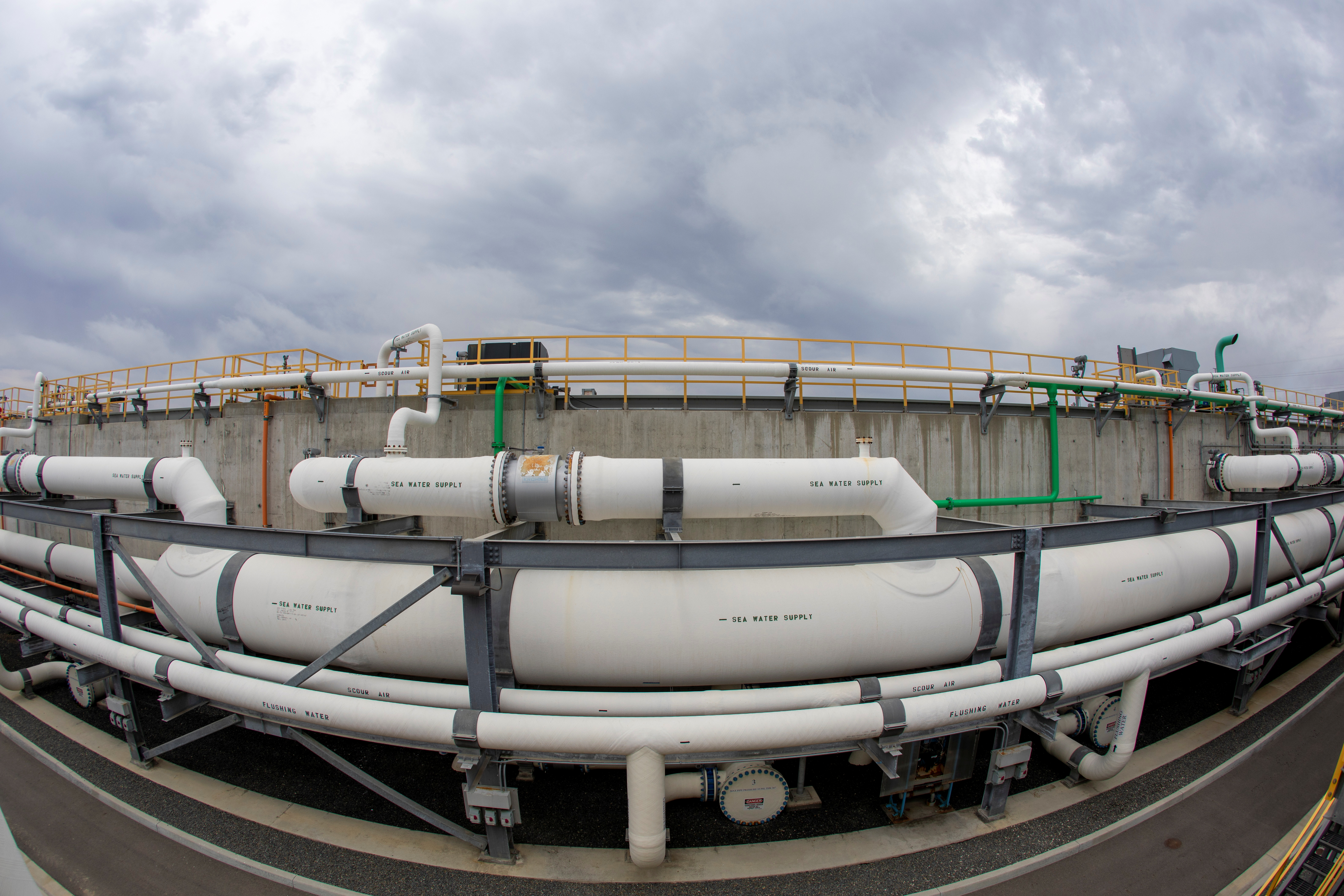 Incoming sea water pipes are shown at the  Poseidon Water desalination plant in Carlsbad, California, U.S., June 22, 2021. REUTERS/Mike Blake