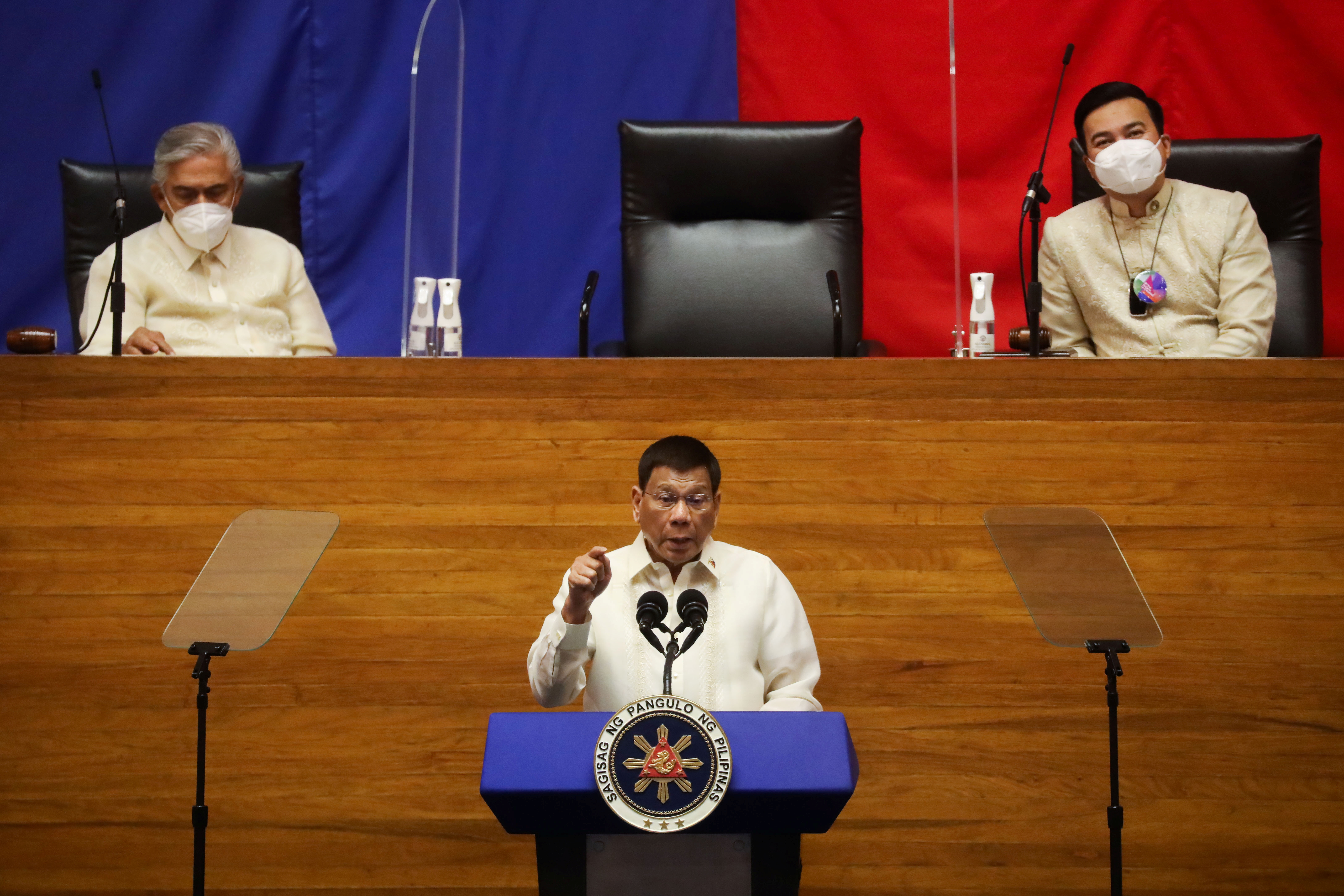 Philippine President Rodrigo Duterte delivers his 6th State of the Nation Address (SONA) as Senate President Vicente Sotto III and House Speaker Lord Allan Velasco listen, at the House of Representative in Quezon City, Metro Manila, Philippines, July 26, 2021. REUTERS/Lisa Marie David