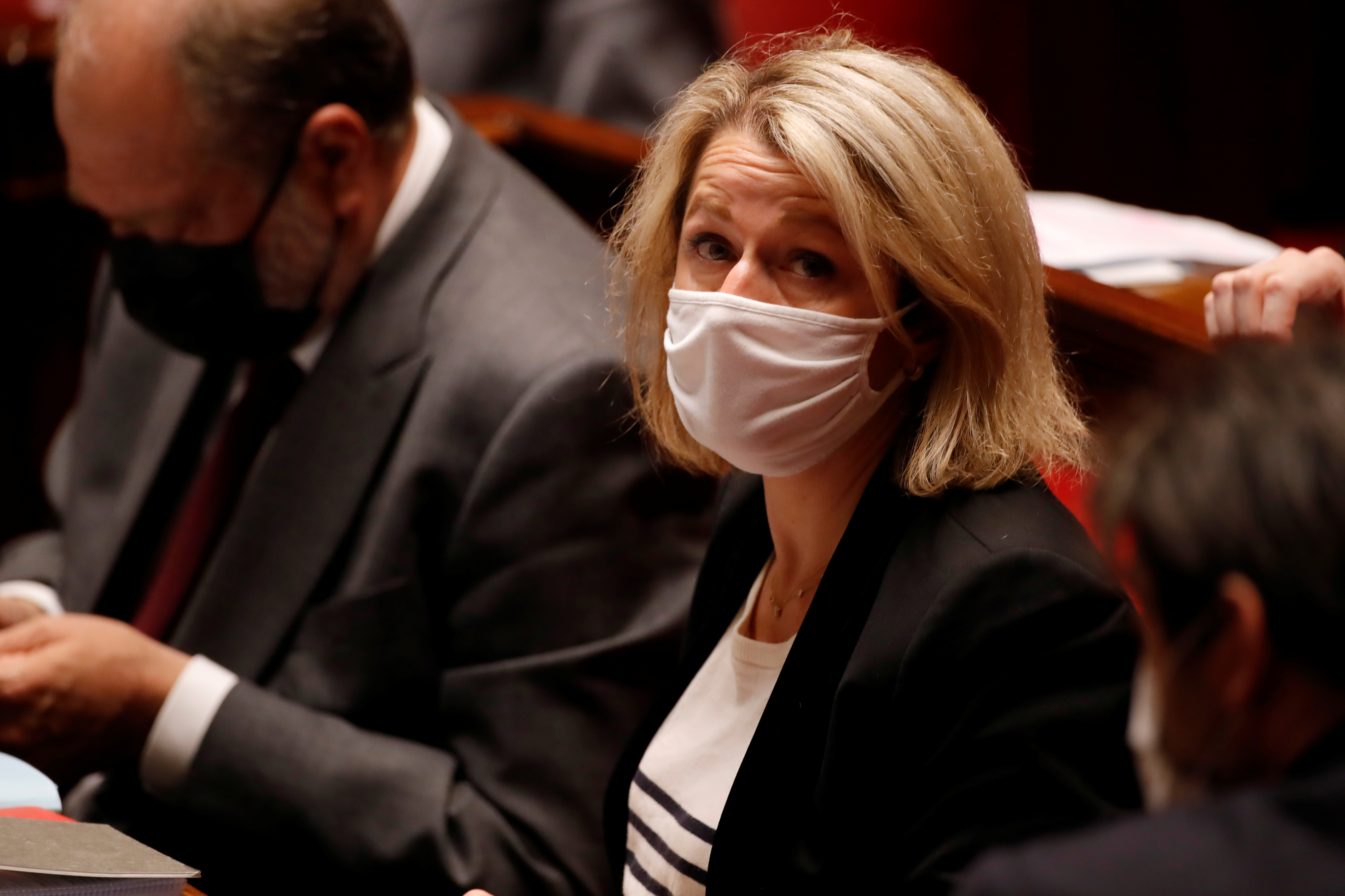 French Ecological Transition Minister Barbara Pompili, wearing a protective face mask, attends the questions to the government session before a final vote on controversial climate change bill at the National Assembly in Paris, France, May 4, 2021. REUTERS/Sarah Meyssonnier