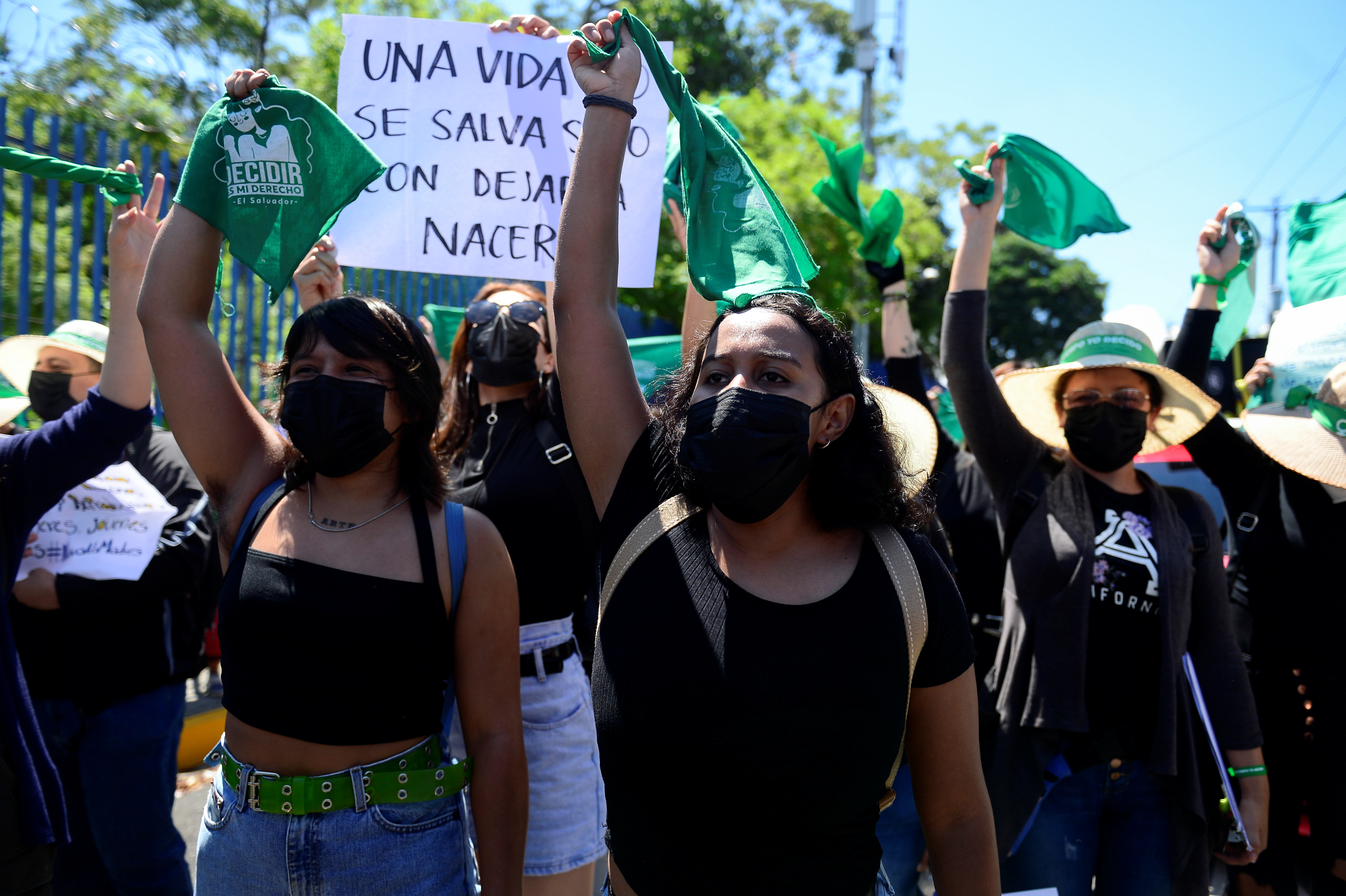 Women hold up green handkerchiefs, symbolizing the abortion rights movement, during a protest to mark International Safe Abortion Day in San Salvador, El Salvador, September 28, 2021. REUTERS/Jessica Orellana