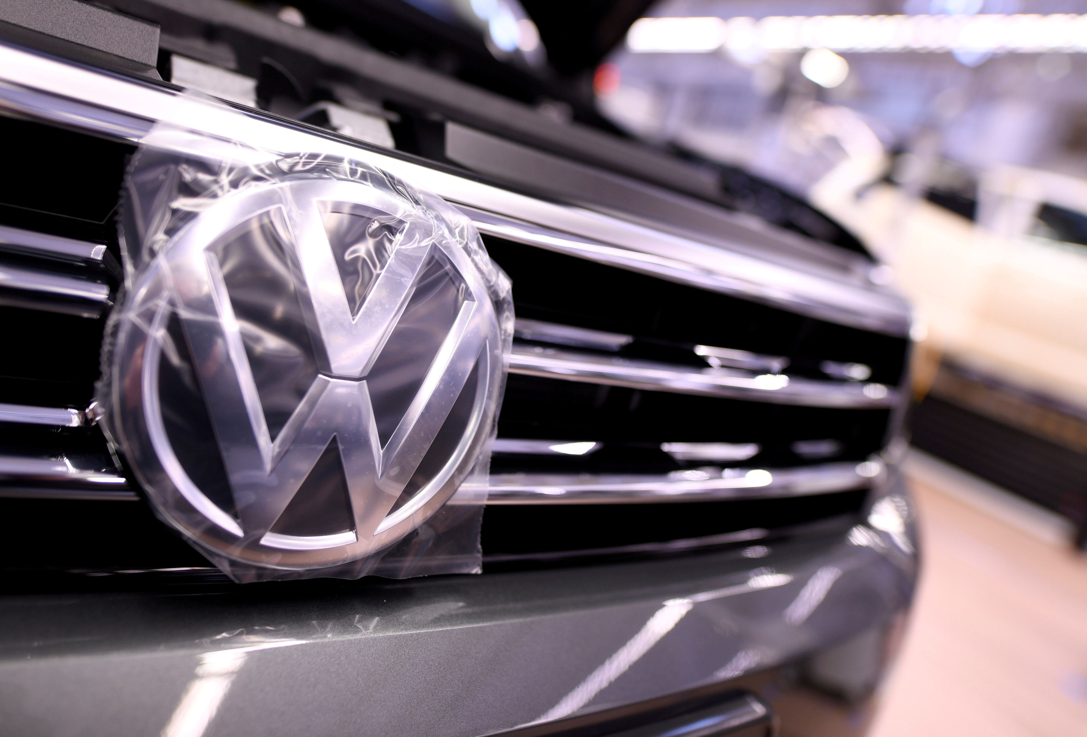 A Volkswagen logo is pictured in a production line at the Volkswagen plant in Wolfsburg, Germany March 1, 2019. Picture taken March 1, 2019. REUTERS/Fabian Bimmer/File Photo