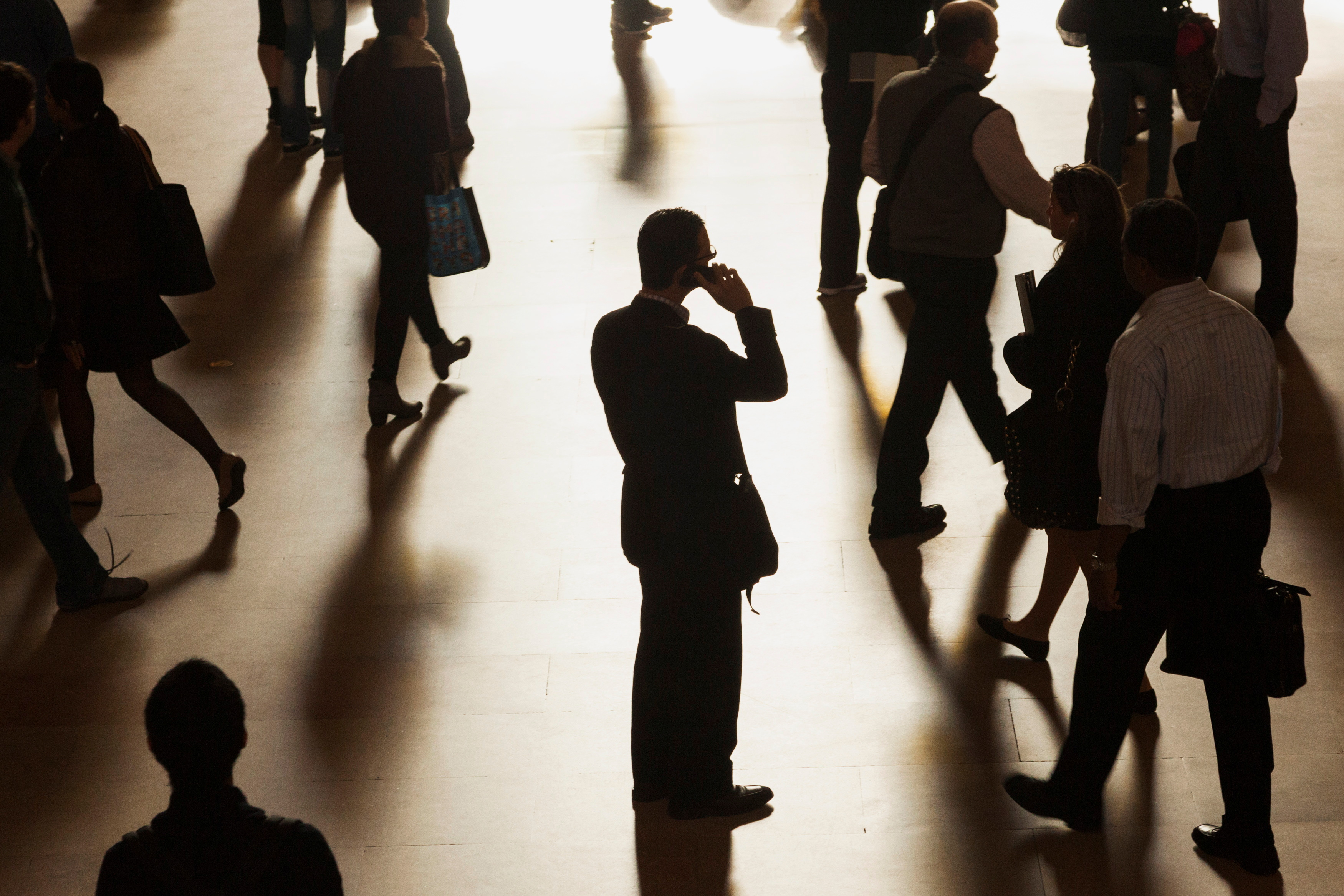 A man stands in the middle of Grand Central Terminal as he speaks on a cell phone in New York, September 25, 2013. REUTERS/Zoran Milich