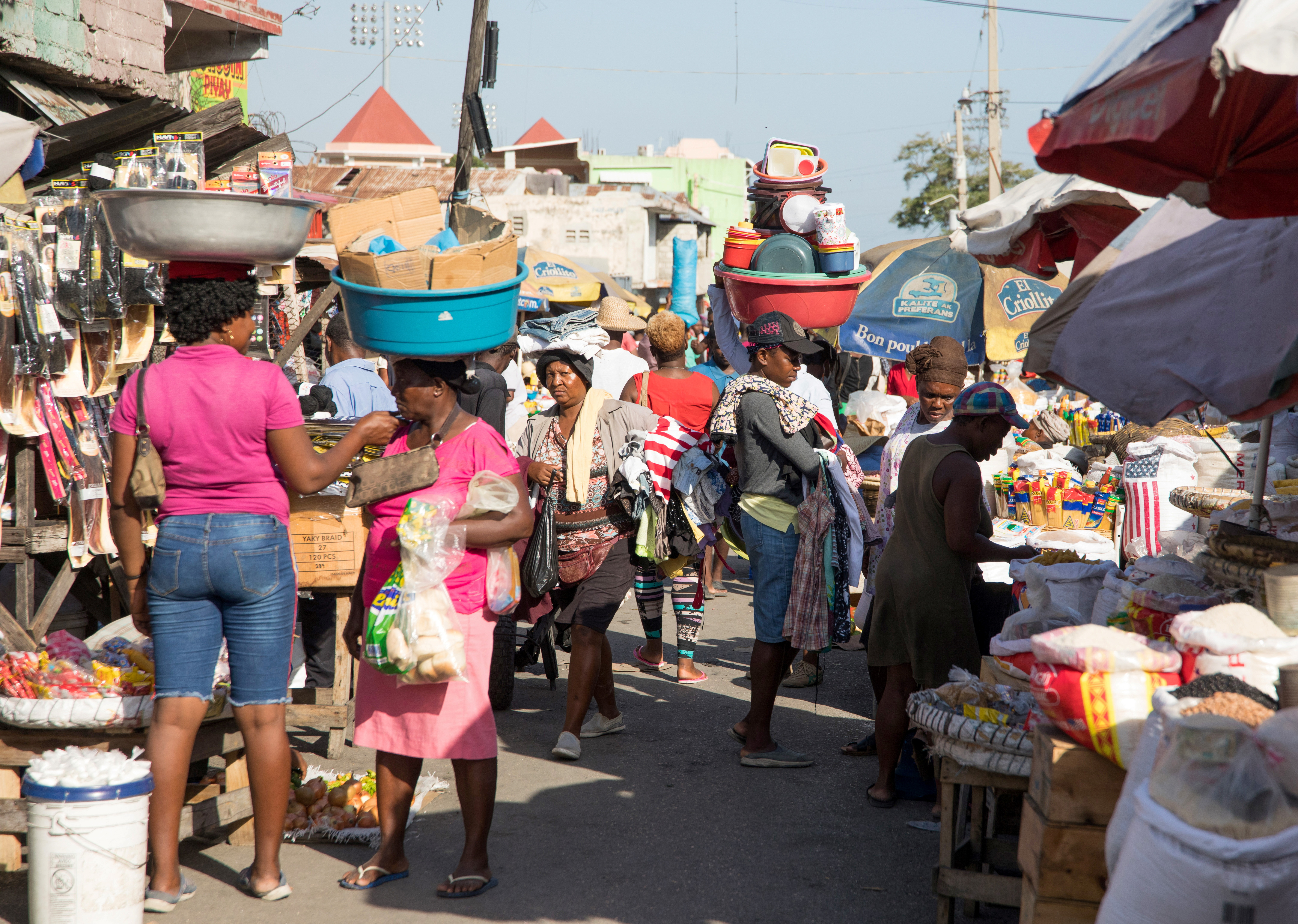 People walk in a market as they go about their lives in Port-au-Prince, Haiti, May 24, 2021. REUTERS/Valerie Baeriswyl