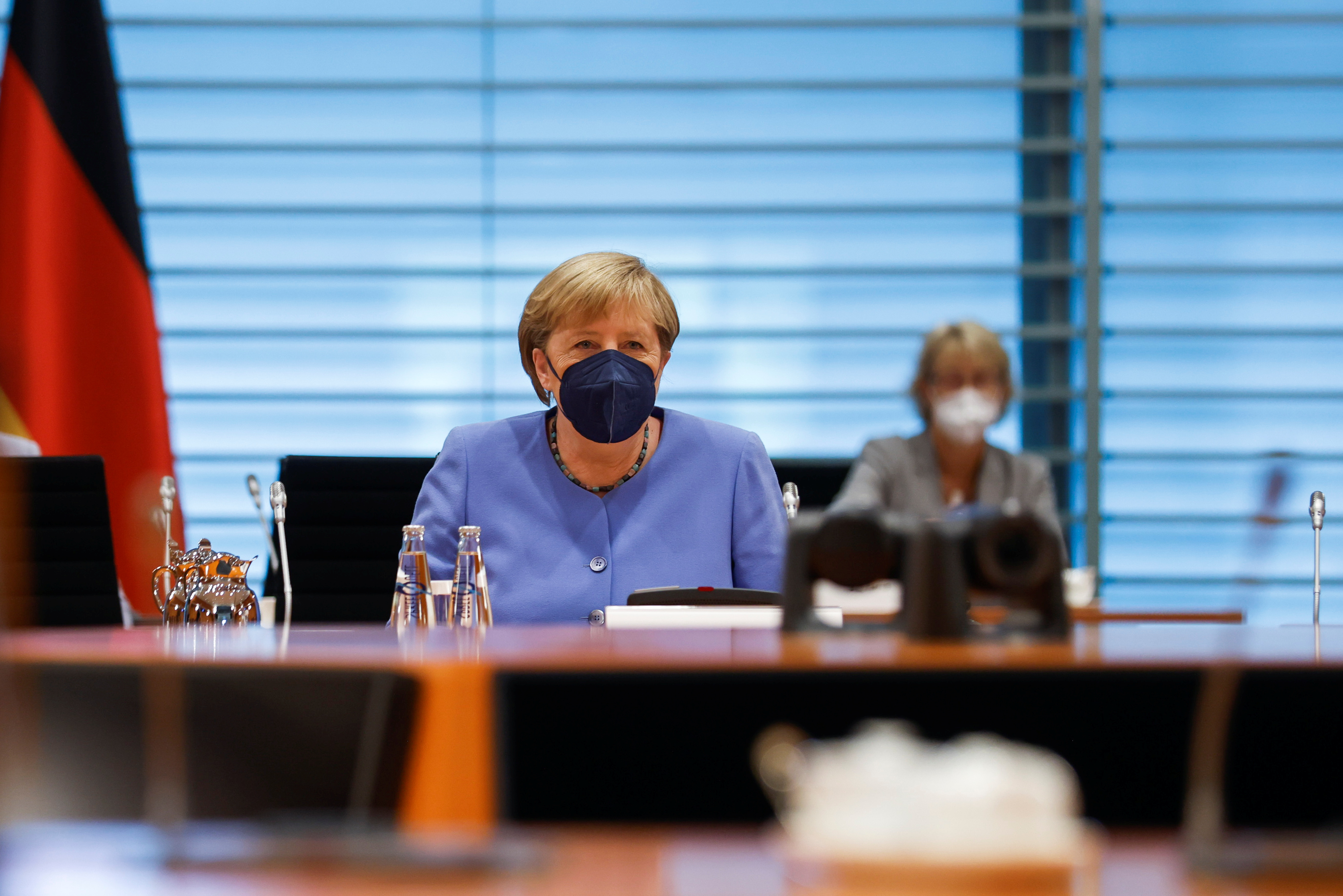 German Chancellor Angela Merkel looks on prior the weekly German cabinet meeting at the Chancellery in Berlin, Germany, July 21, 2021. REUTERS/Axel Schmidt/Pool