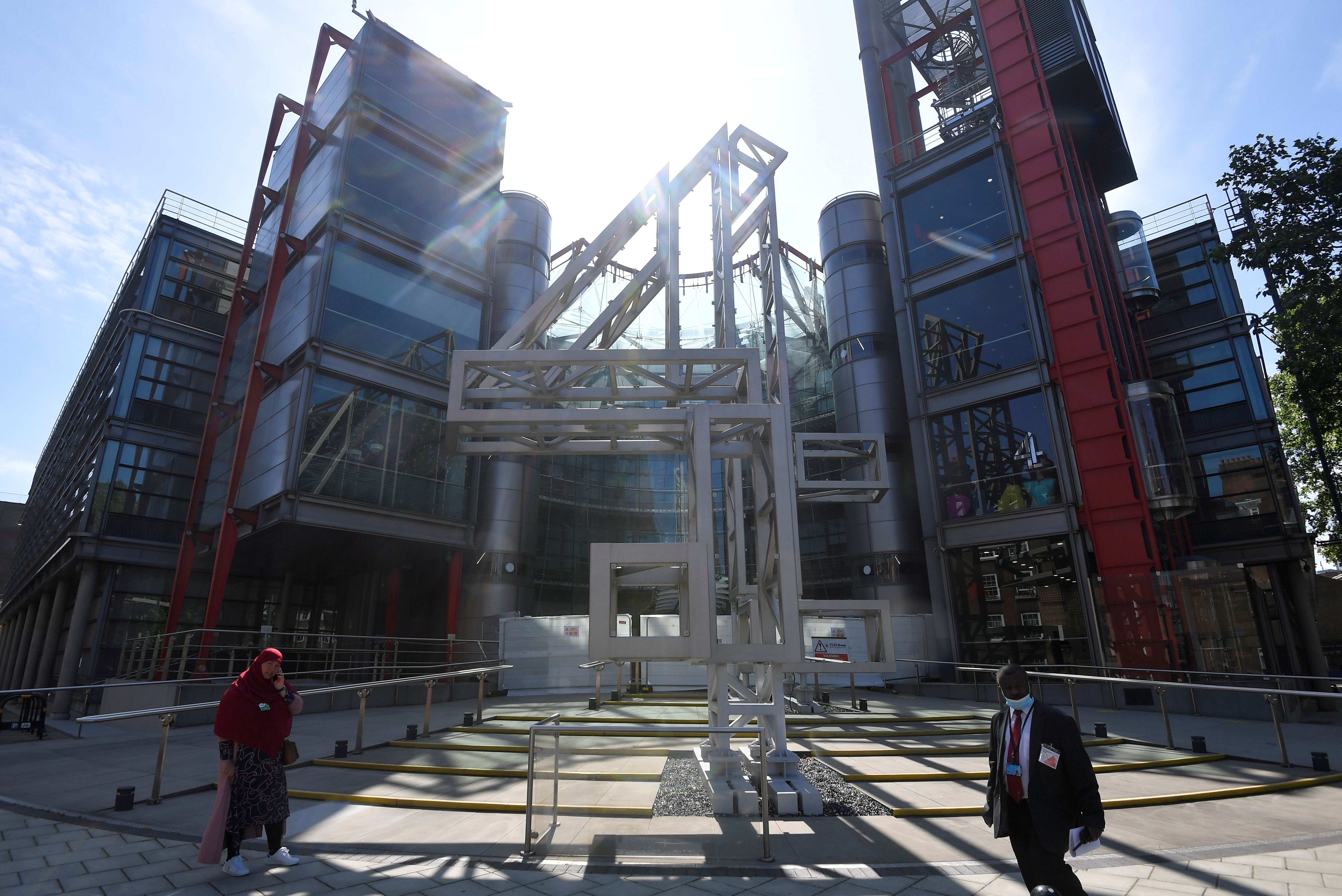 People walk past the Channel 4 television channel offices in London, Britain, June 23, 2021. REUTERS/Toby Melville/File Photo