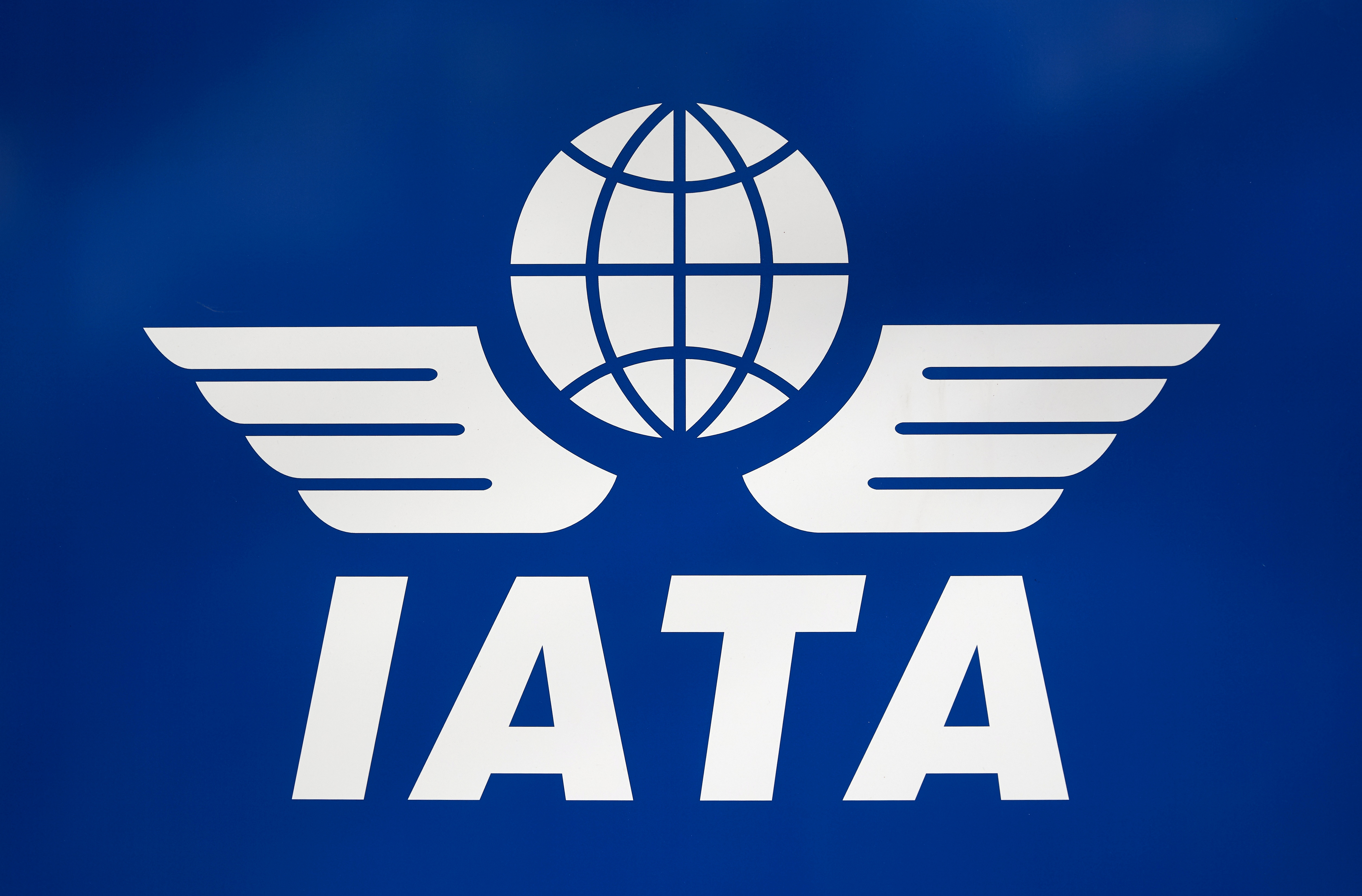 A logo of the International Air Transport Association (IATA) is pictured in Geneva, Switzerland, March 13, 2020. REUTERS/Denis Balibouse/File Photo
