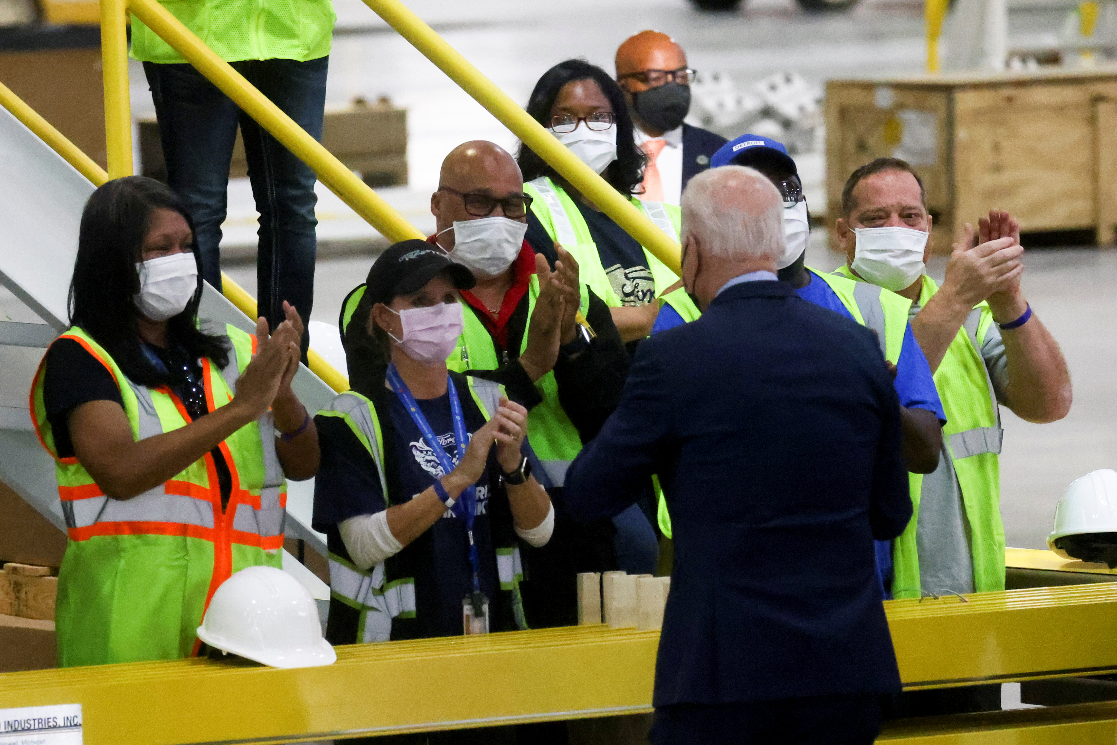 U.S. President Joe Biden greets workers after delivering remarks during a visit to Ford Rouge Electric Vehicle Center in Dearborn, Michigan, U.S., May 18, 2021.  REUTERS/Leah Millis