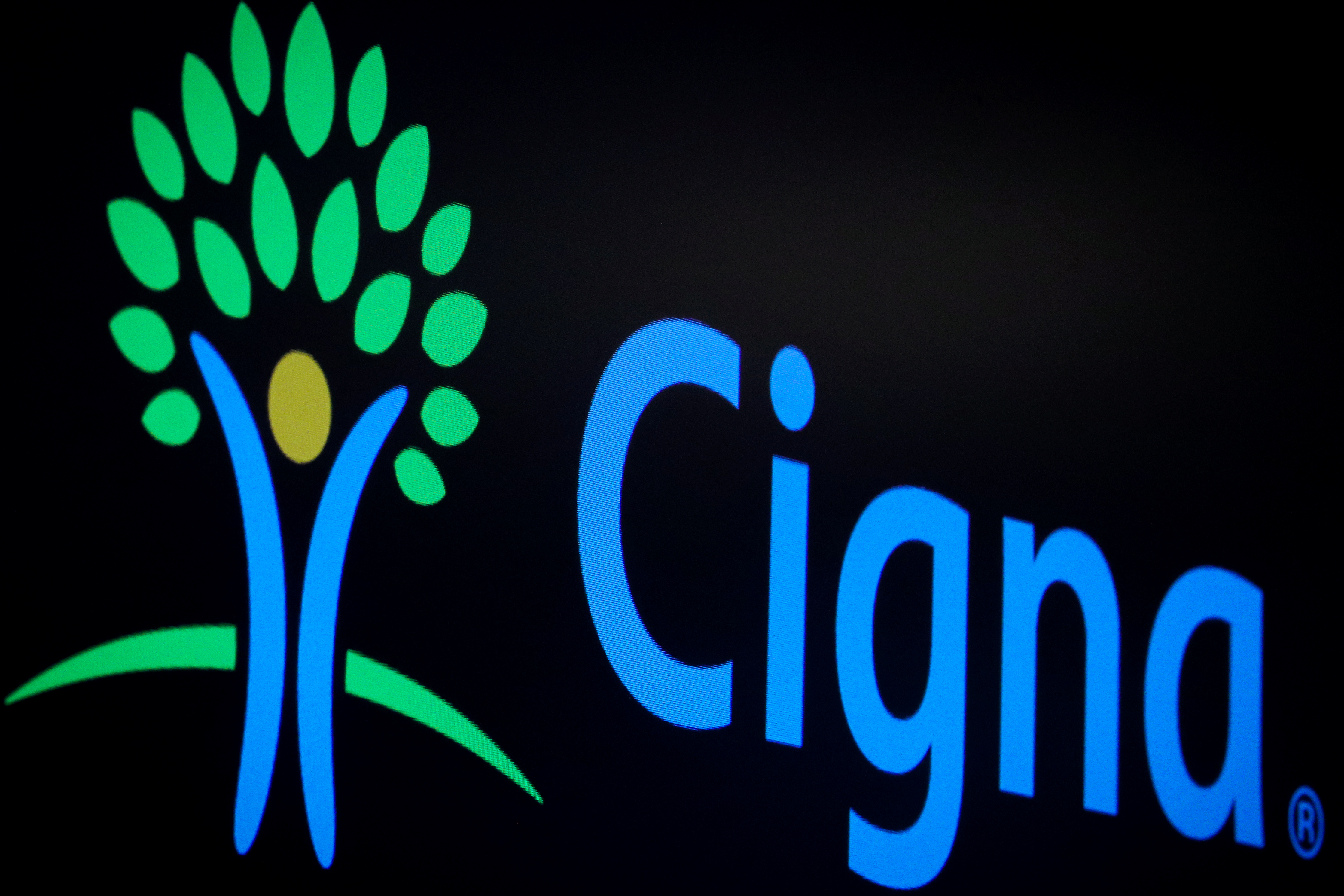 A screen displays the logo fro Cigna Corp. on the floor at the New York Stock Exchange (NYSE) in New York, U.S., July 16, 2019. REUTERS/Brendan McDermid