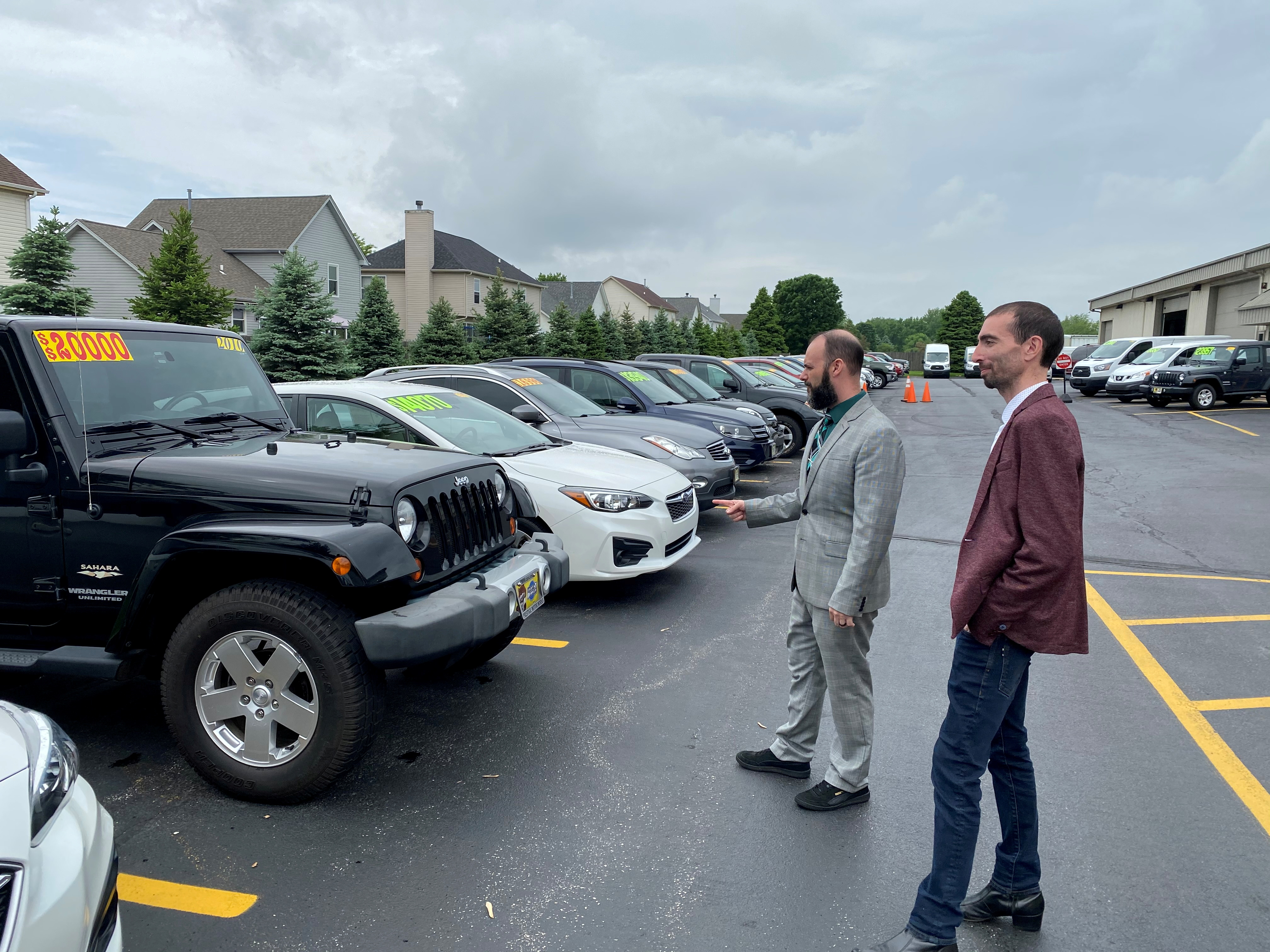 Alex Tovstanovsky, owner of used-car dealer Prestige Motor Works, checks on inventory with his general manager Ryan Caton in Naperville, Illinois, U.S. May 28, 2020. Picture taken May 28, 2020.  REUTERS/Nick Carey/File Photo