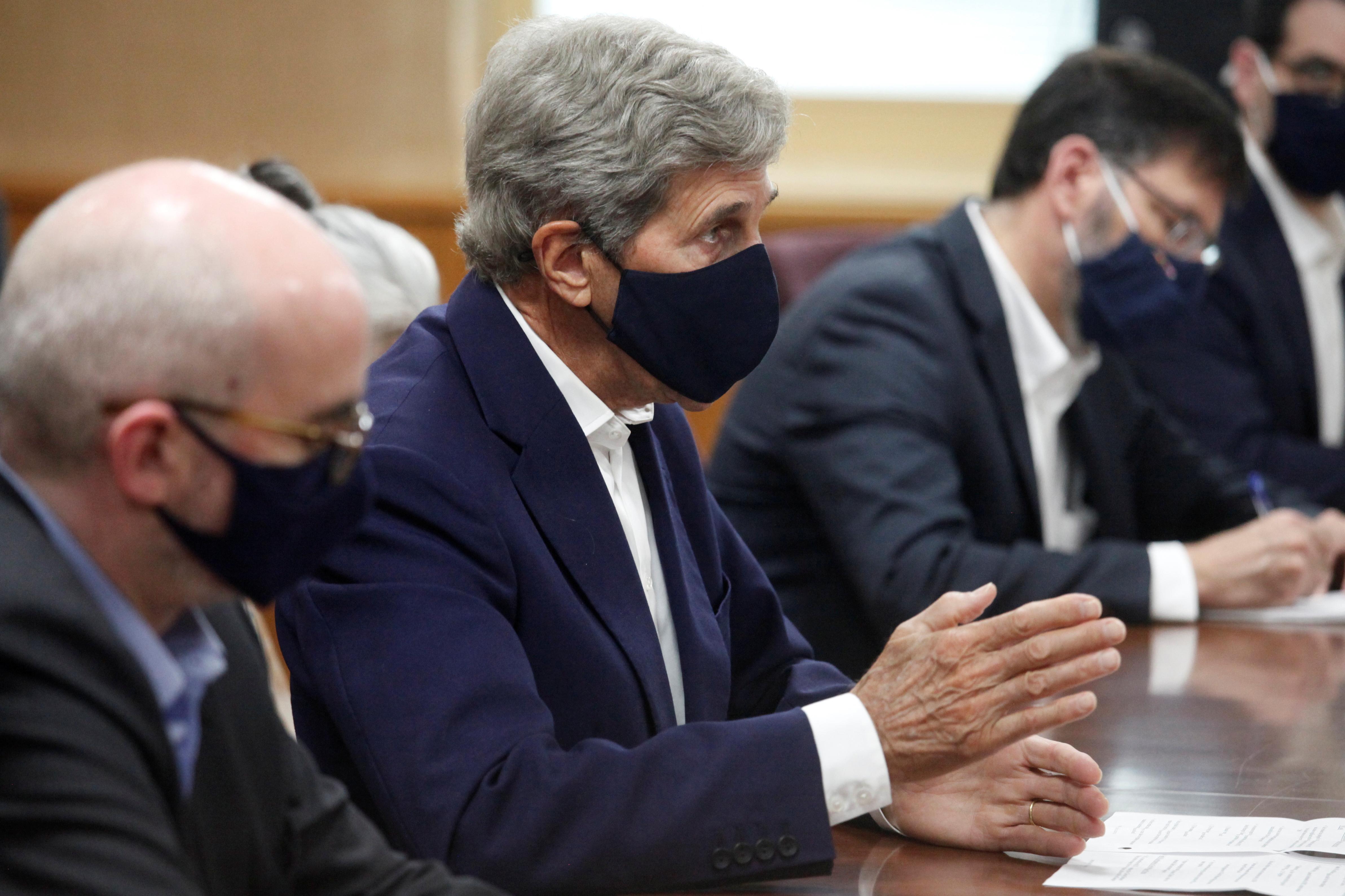 U.S. Special Presidential Envoy for Climate John Kerry talks with Japanese Minister of the Environment Shinjiro Koizumi in Tokyo, Japan, August, 31, 2021.  Koji Sasahara/Pool via REUTERS
