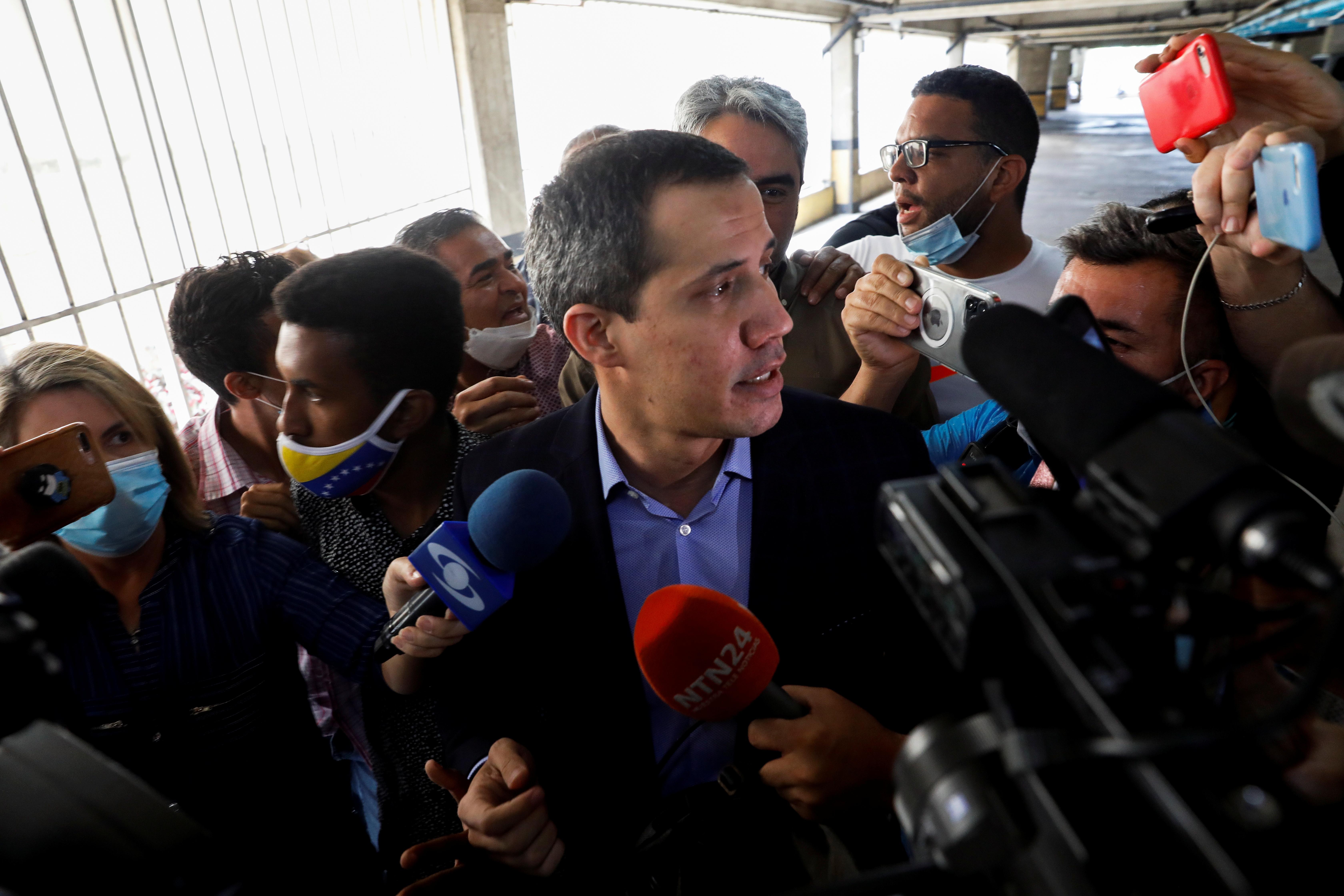 Venezuela's opposition leader Juan Guaido speaks to the media, in Caracas, Venezuela July 12, 2021.  REUTERS/Leonardo Fernandez Viloria