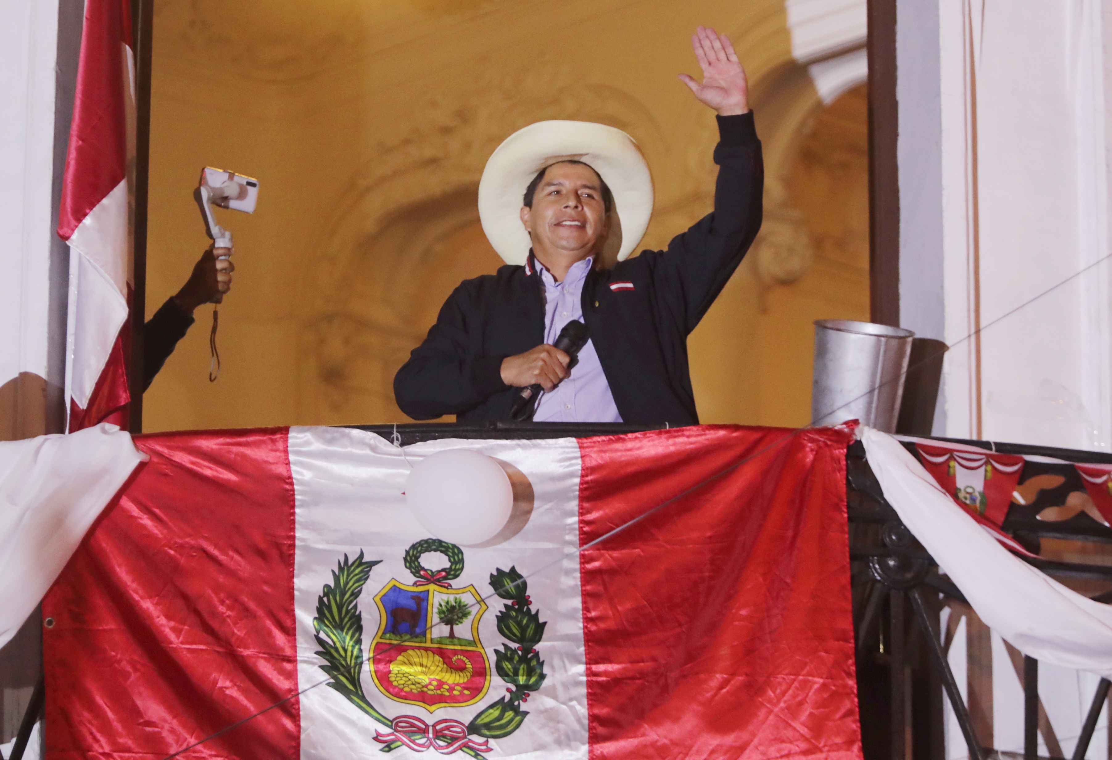 FILE  PHOTO: Peru's presidential candidate Pedro Castillo gestures to supporters the day after a run-off election, in Lima, Peru June 7, 2021. REUTERS/Sebastian Castaneda