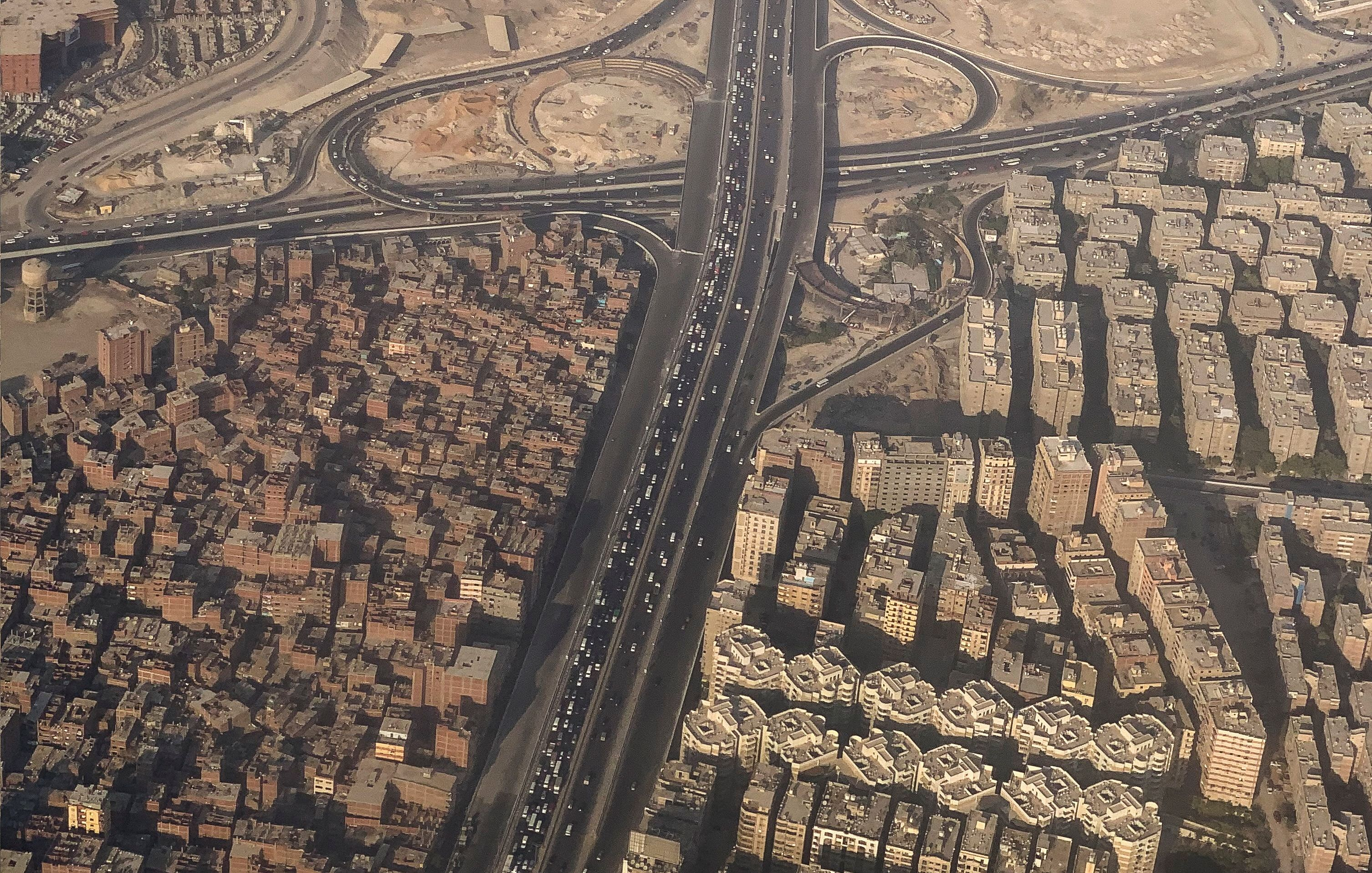 An aerial view of Cairo's traffic and compressed houses with new houses project is pictured through the window of an airplane on a flight between Cairo and Doha, Egypt August 10, 2021.   REUTERS/Amr Abdallah Dalsh